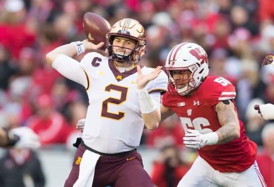 Nov 24, 2018; Madison, WI, USA; Minnesota Golden Gophers quarterback Tanner Morgan (2) throws a pass under pressure from Wisconsin Badgers linebacker Zack Baun (56)vduring the first quarter at Camp Randall Stadium.