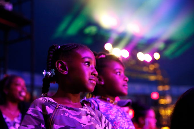 I attended my first UniverSoul Circus performance this summer. I was excited for the opportunity to photograph the circus, but the lighting was challenging at times. My goal was to show the emotion of the children while still showing the vibrant colors under the tent. I was able to capture this when I saw the faces of the girls and the colors of the lights. I knew it would make for a beautiful photo.   Jazz Rodgers, left, and her cousin Jackson Rodgers, both 7, watch entertainers during the UniverSoul Circus Thursday, Aug. 23, 2018. UniverSoul Circus is recognized for its high-energy atmosphere with acts from around the globe – including the U.S., Trinidad and Tobago, Ethiopia, Gabon, Colombia and China.
