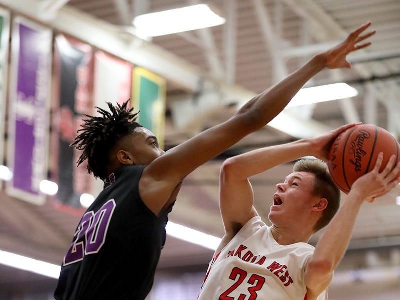 Lakota West guard  Matthew Oehler (23) drives to the basket against Middletown forward  Johrdon Mumford (20)  during their  basketball game  Tuesday, Dec. 11,2018.