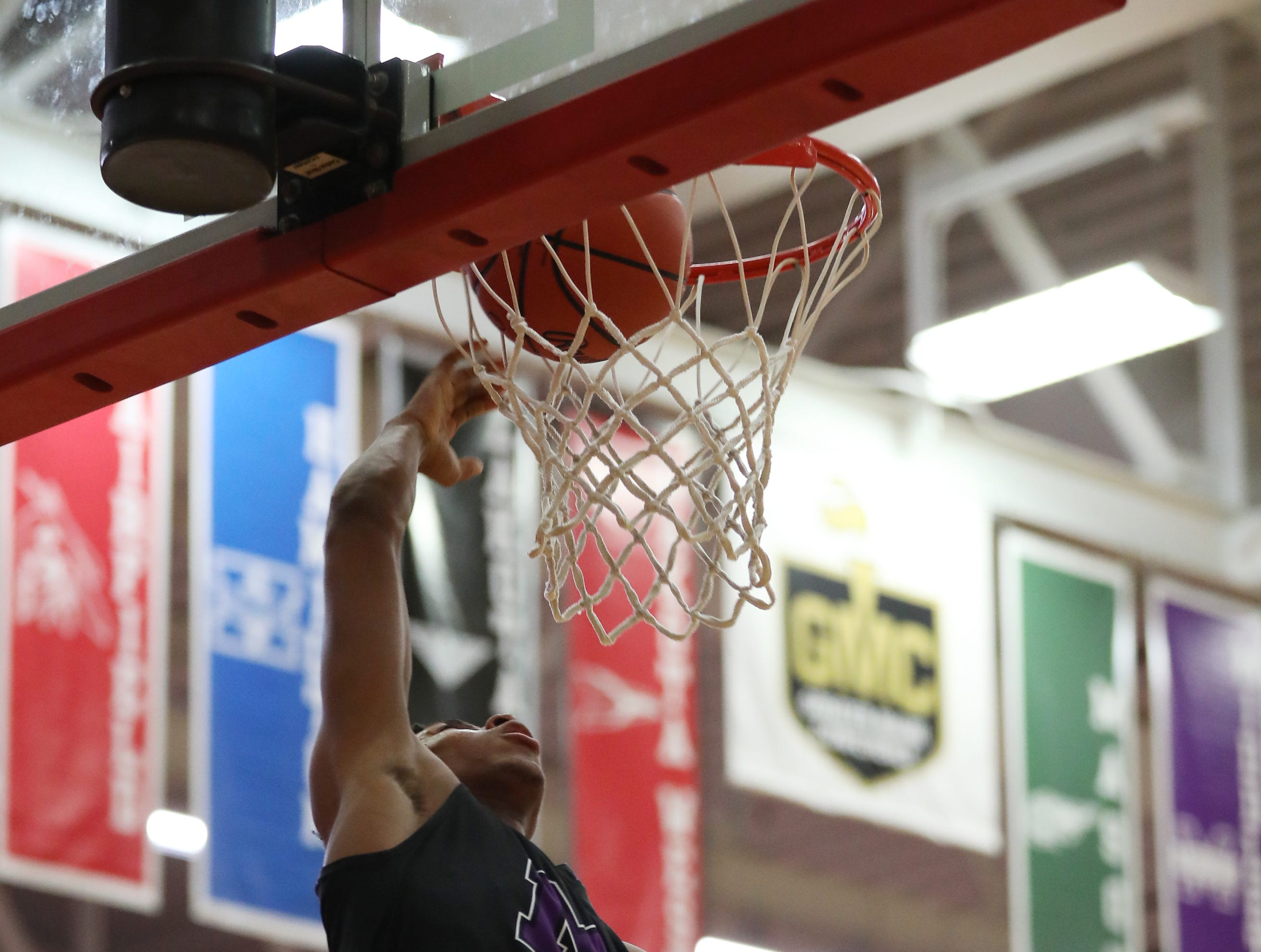 Middletown guard Shandon Morris dunks the ball during the Middies' basketball game against Lakota West, Tuesday, Dec. 11,2018.
