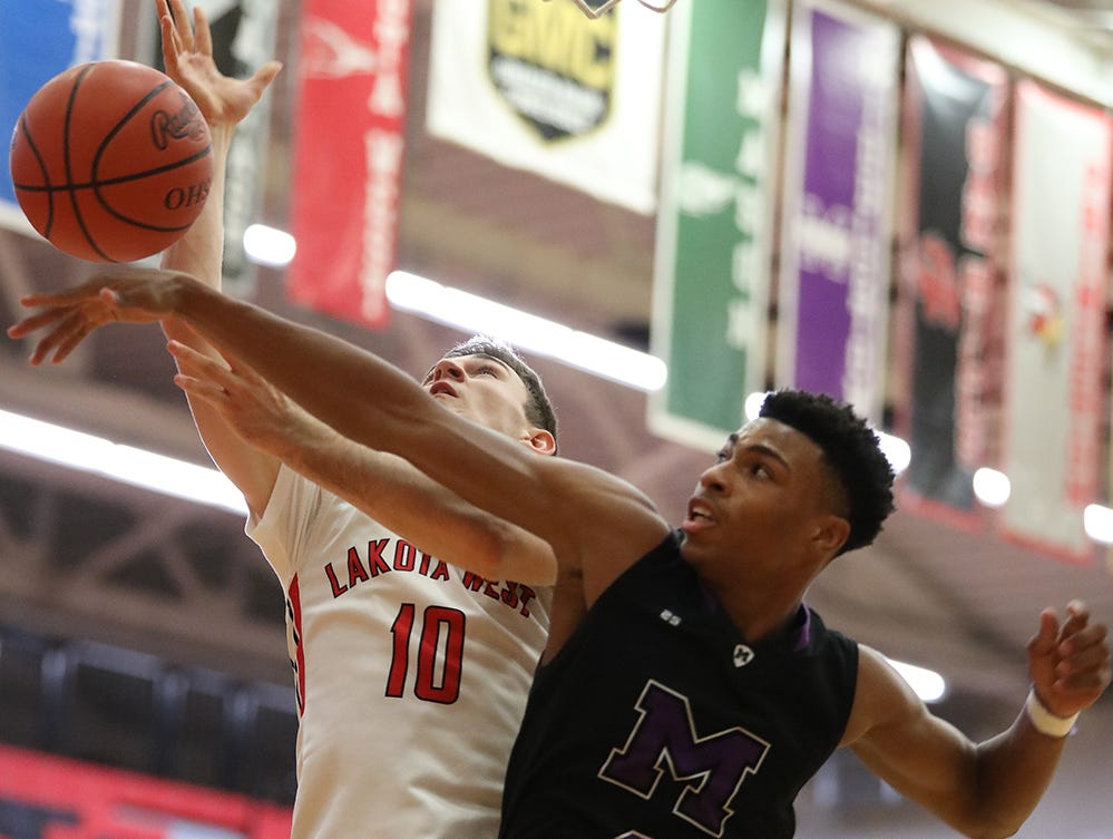 Middletown guard  Shandon Morris (2) knocks the ball away from Lakota West guard  Bradley Groth (10) during their basketball game , Tuesday, Dec. 11,2018. West won 64-56