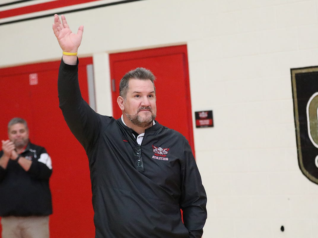 New Lakota West football coach Tom Bolden waves to the crowd at the boys basketball game against Middletown, Tuesday, Dec. 11,2018.