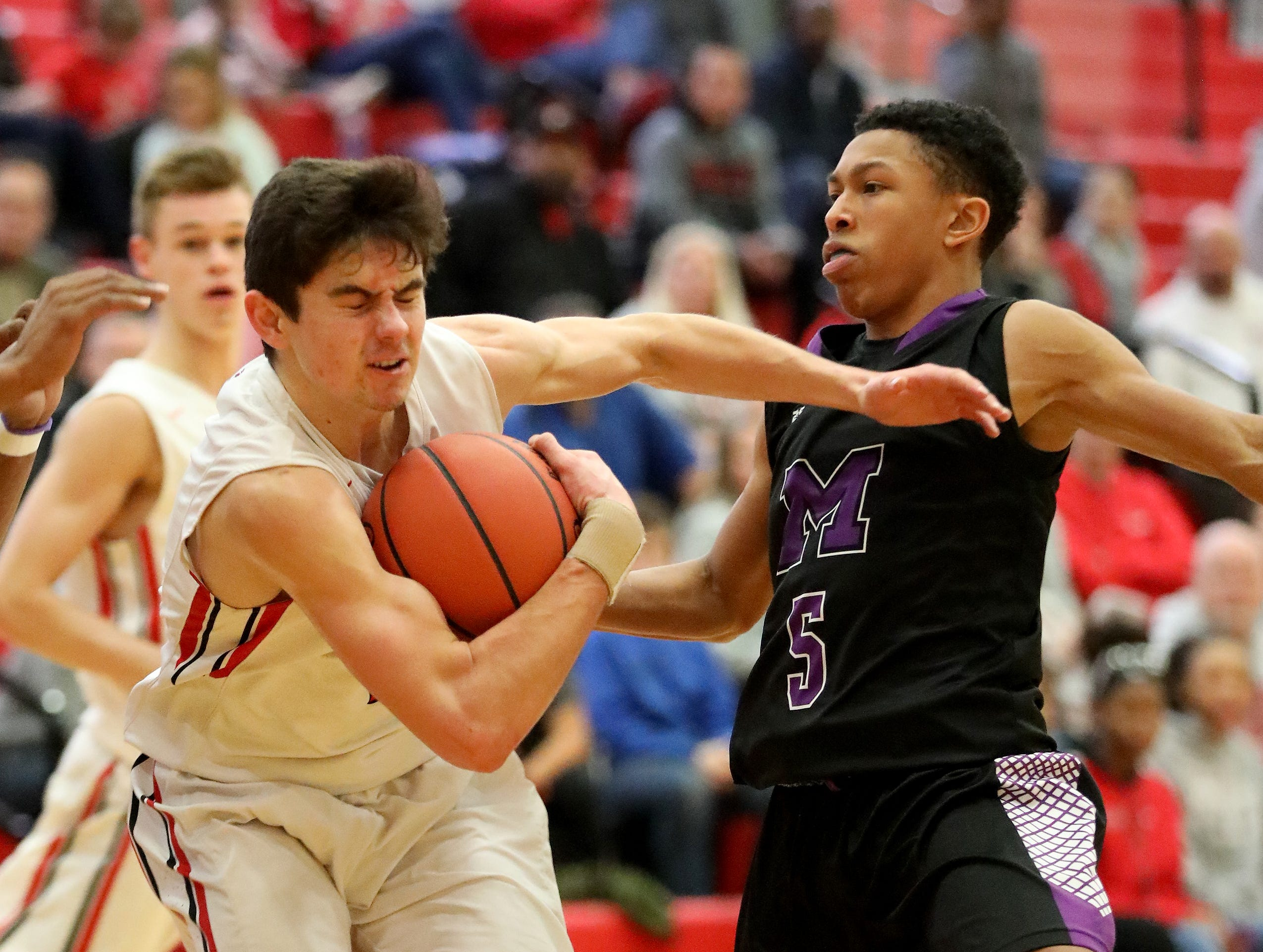 Lakota West guard Matt Desalvo (5) drives to the  basket against Middletown guard Kadar Gardner during their  basketball game , Tuesday, Dec. 11,2018. West won 64-56.