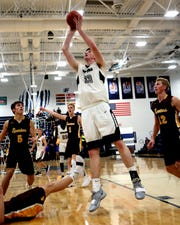West Clermont center Jackson Ames scores from the paint. Turpin defeated West Clermont 70-51.