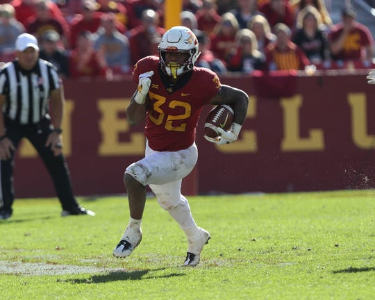 Oct 27, 2018; Ames, IA, USA; Iowa State Cyclones running back David Montgomery (32) runs the football against the Texas Tech Red Raiders at Jack Trice Stadium. The Cyclones beat the Red Raiders 40 to 31.