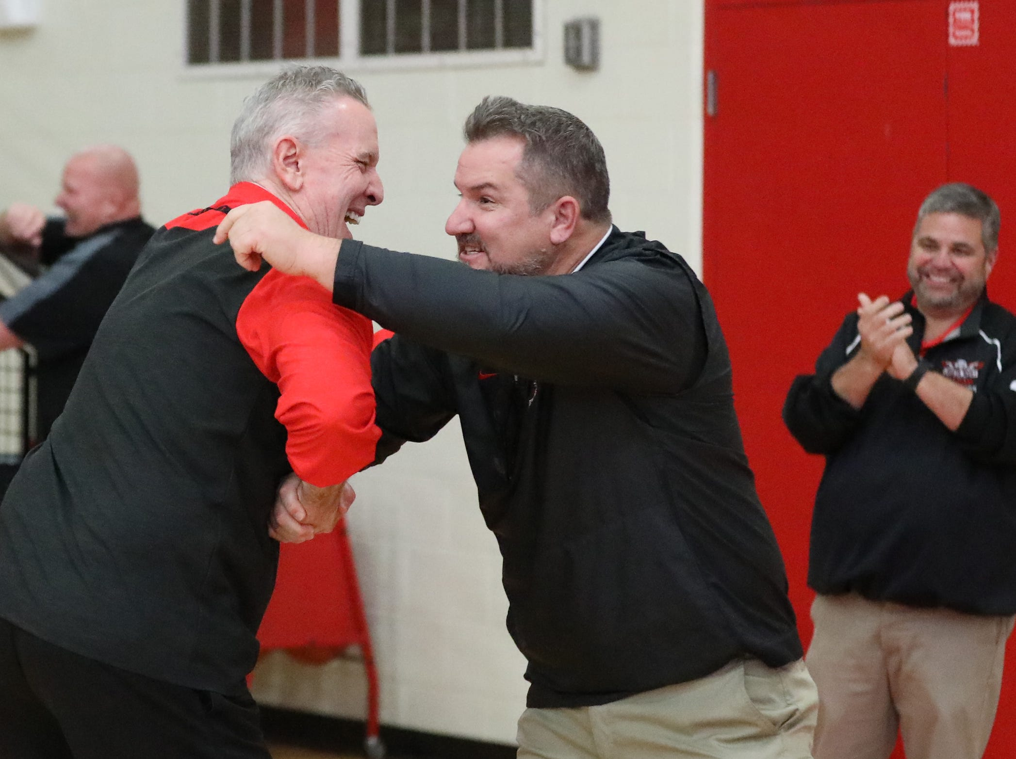 New Lakota West football coach Tom Bolden and basketball coach Jim Leon   at the boys basketball game against Middletown, Tuesday, Dec. 11,2018.
