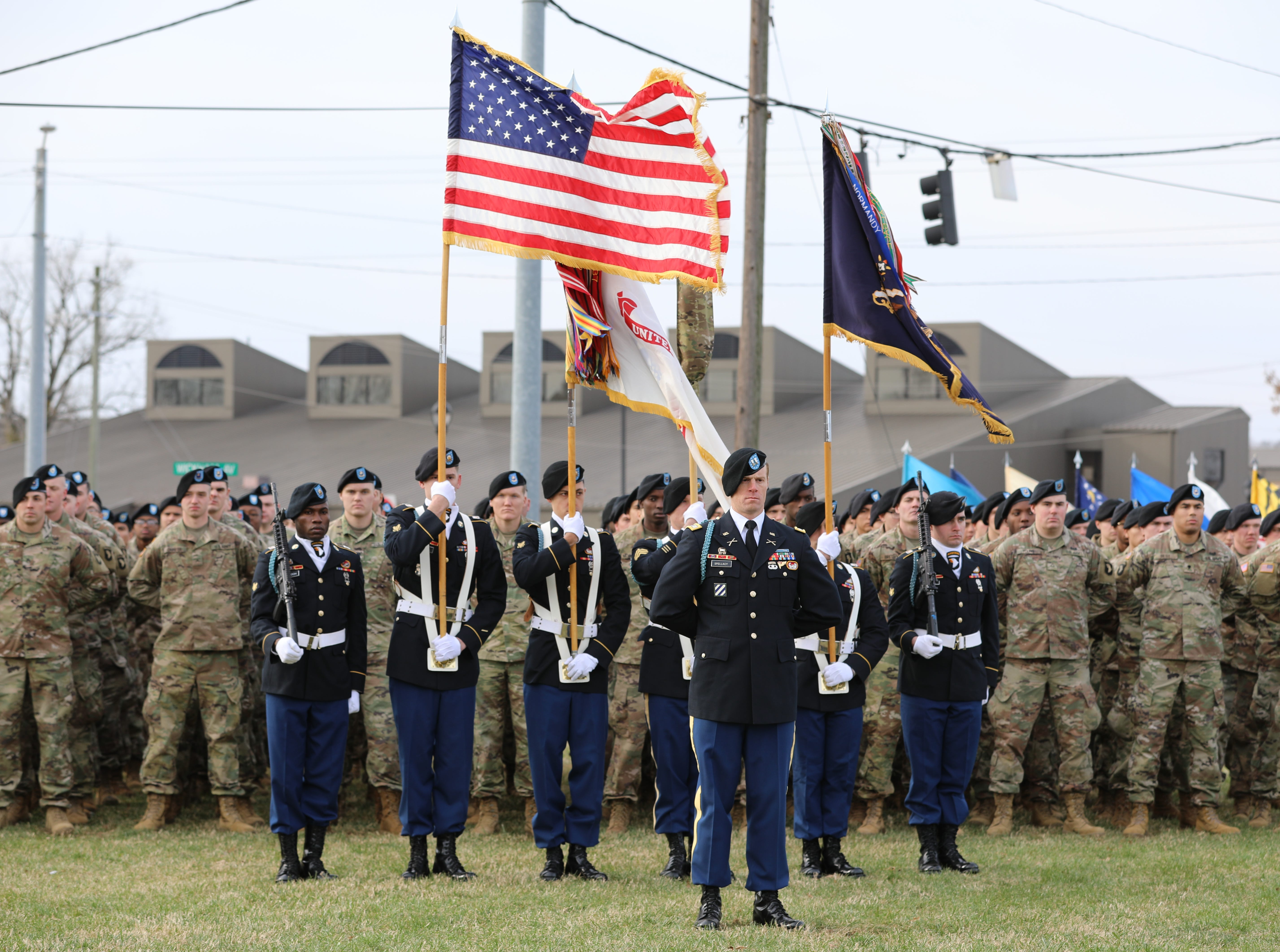 Soldiers and Color guard stand on the Gander Memorial grounds to pay tributes to the fallen Soldiers of Gander at Fort Campbell, KY Dec. 12, 2018.