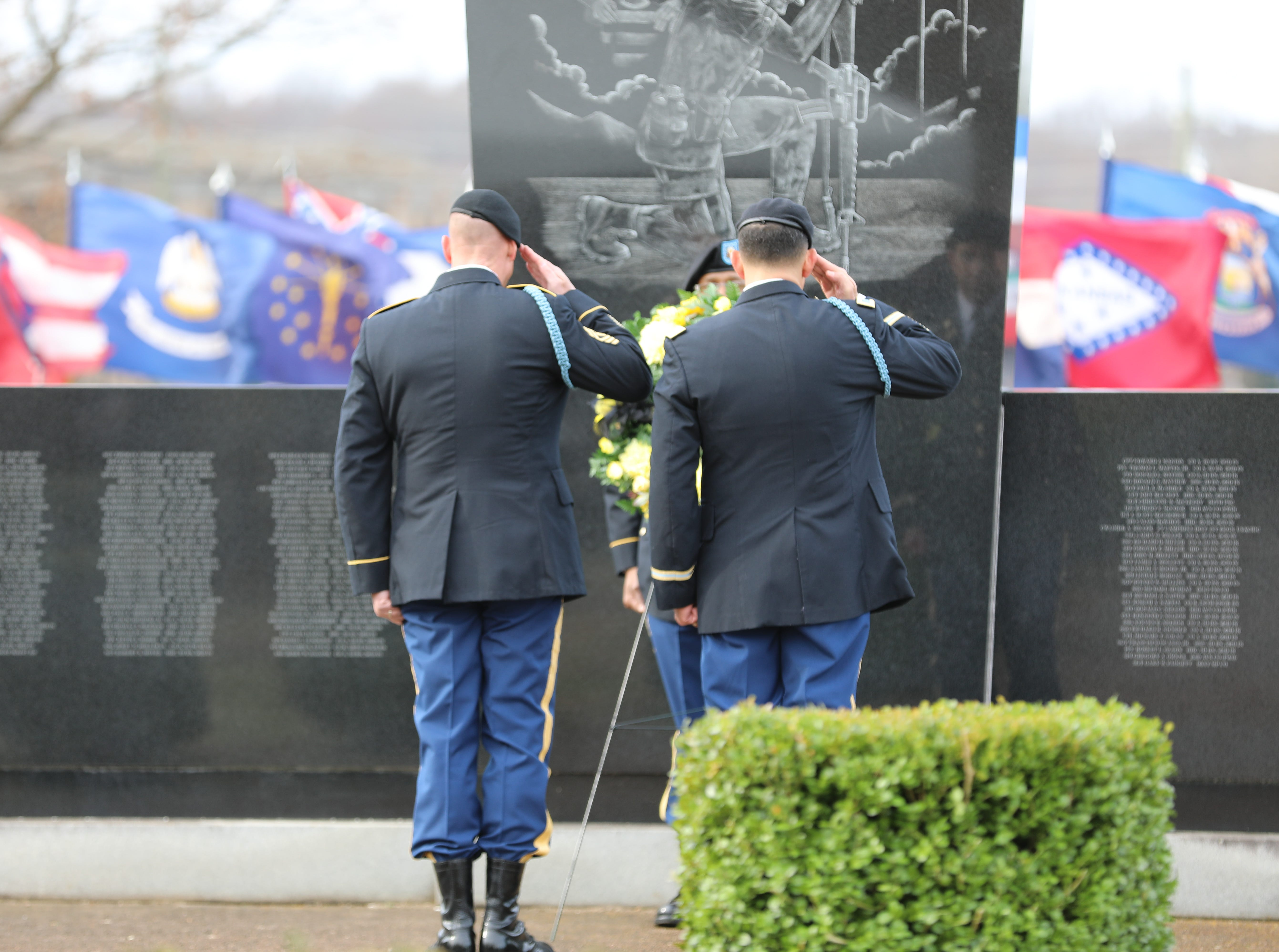 Col. Joseph Escandon and CSM Thomas R. Conn Jr. salute the Gander Memorial after laying the wreath at Fort Campbell, KY Dec. 12, 2018.