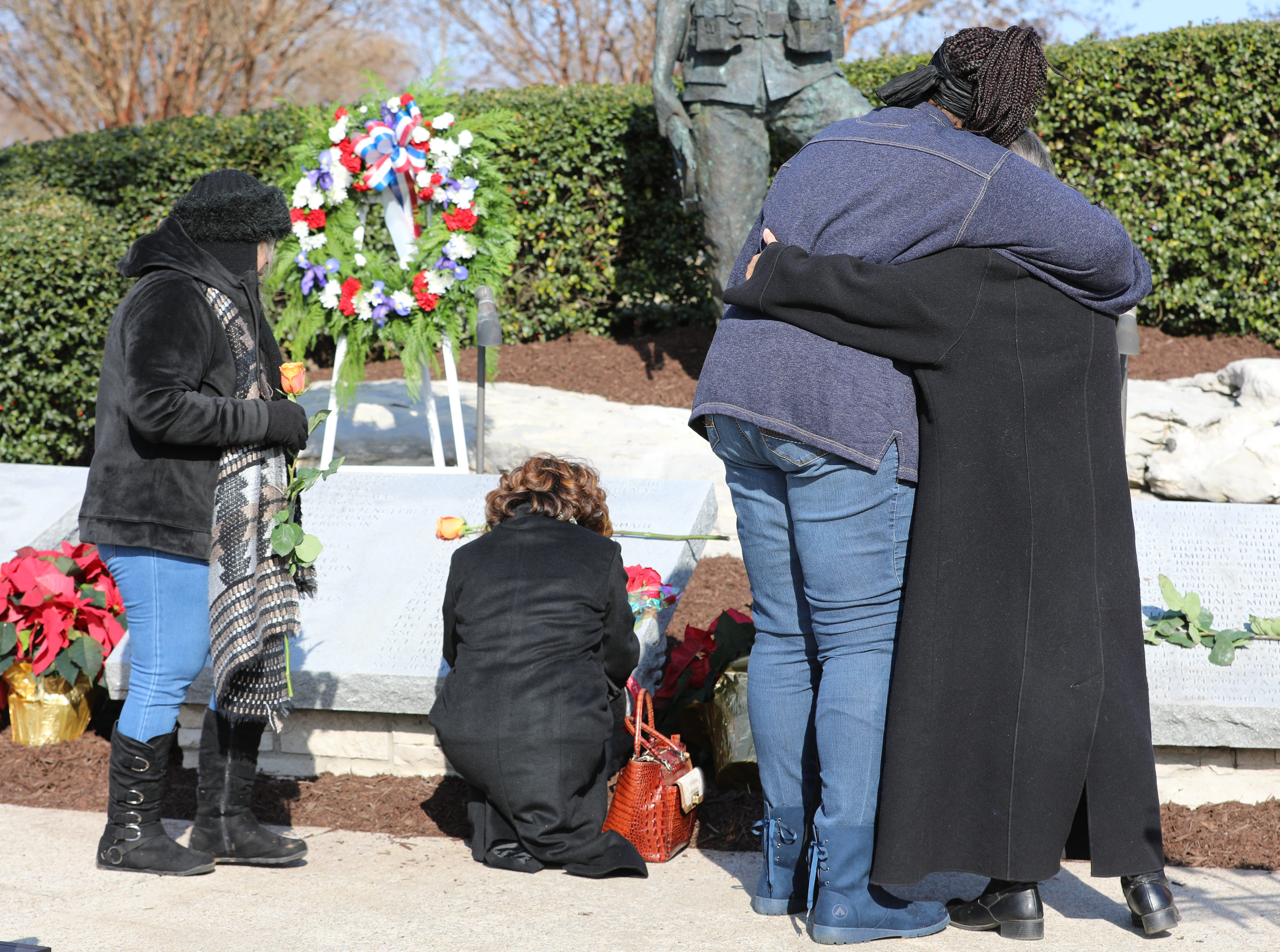 Family gather and hold each other at the Gander Memorial in Hopkinsville, KY Dec. 12,2018.