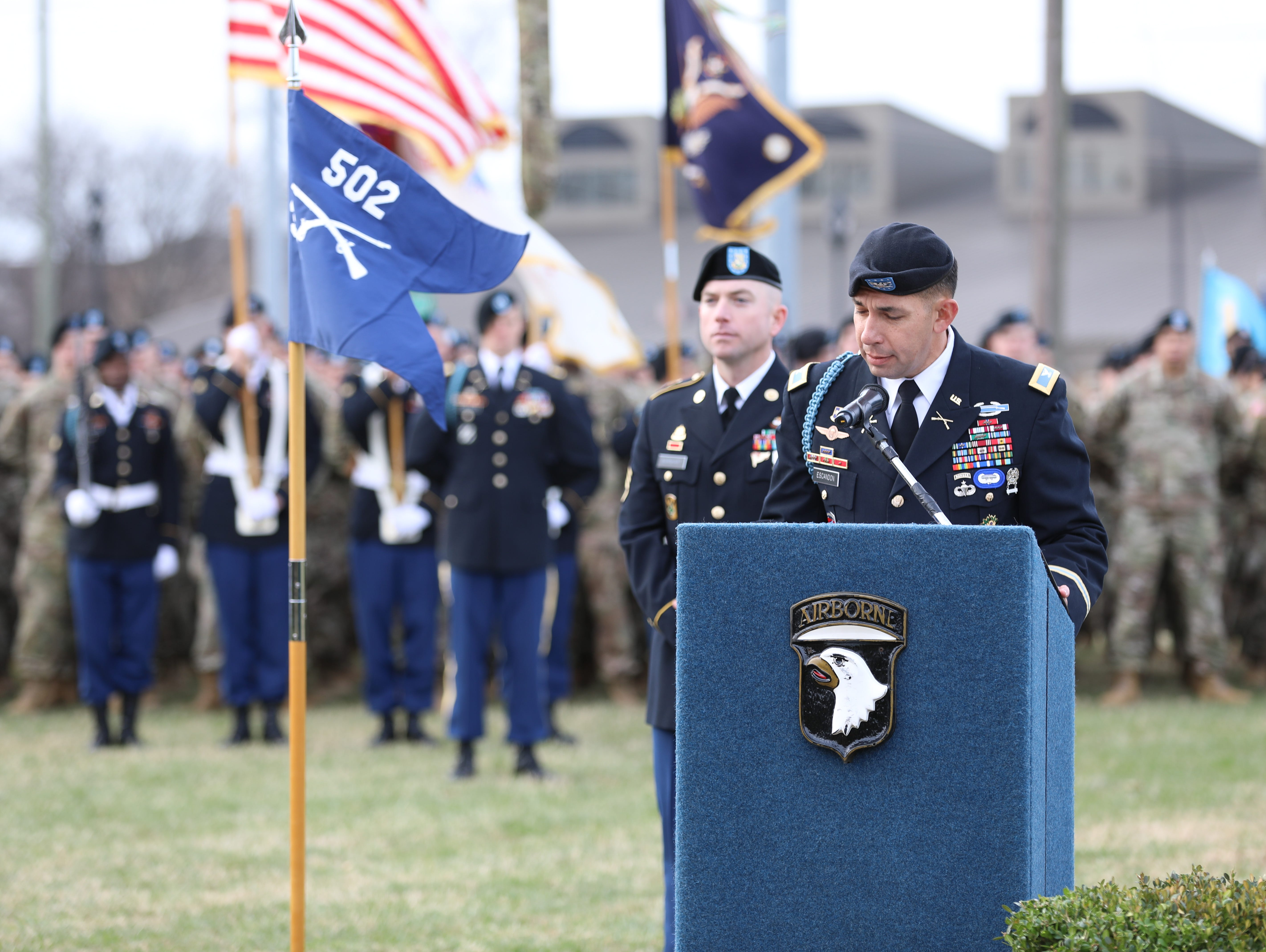 Staff Sgt. Jerald Burnhart (left) interduces Col. Joseph Escandon (right), as he gives his speech at the Gander Memorial at Fort Campbell, KY Dec. 12, 2018.