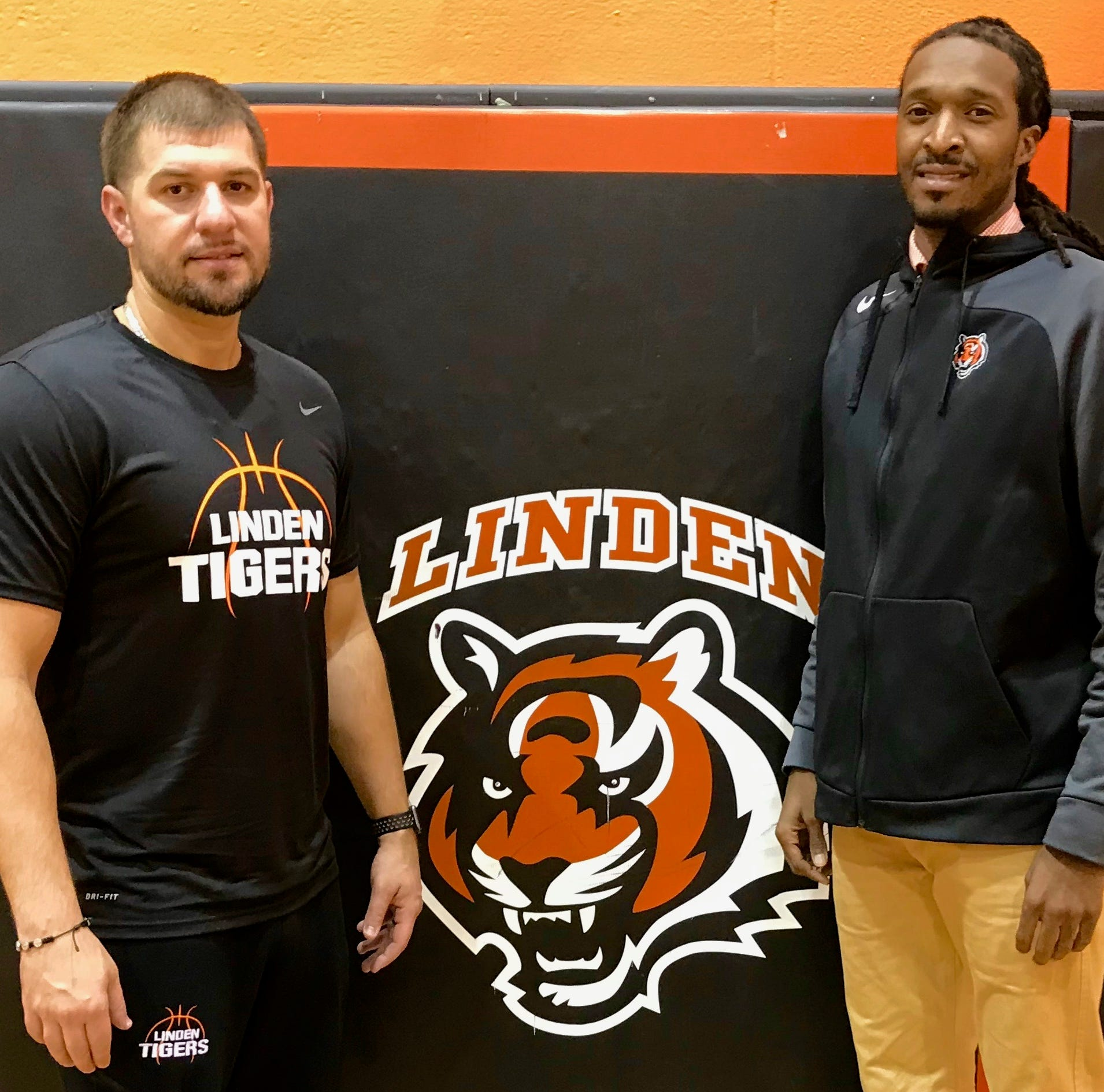 New head basketball coaches Anthony Drejaj and James Harper in the Linden High School gym.