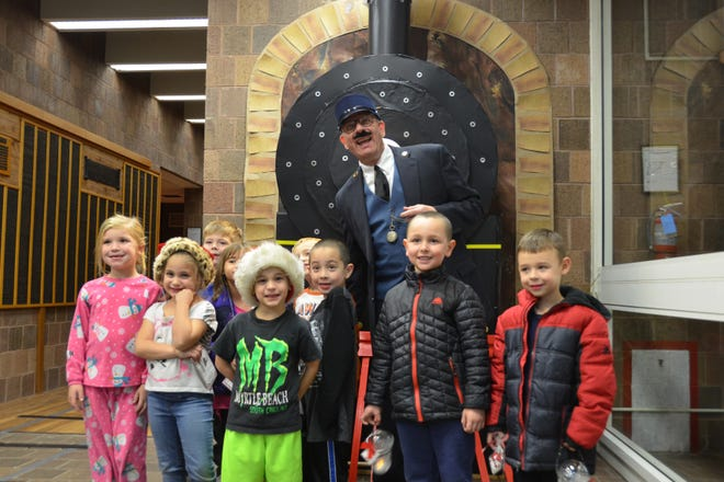 Pictured are SCLSNJ Bridgewater staff member Brian Holovach as the conductor (center), surrounded by first graders from Weston Elementary School (back row, left to right): Ryan Hohnhorst, Kelly Flynn, and AJ Kling; and (front row, left to right): Alexandra Fleming, Gina Gall, Dominic Gall, Ian Sawyer, Nathan Taalu and Kevin Flynn.