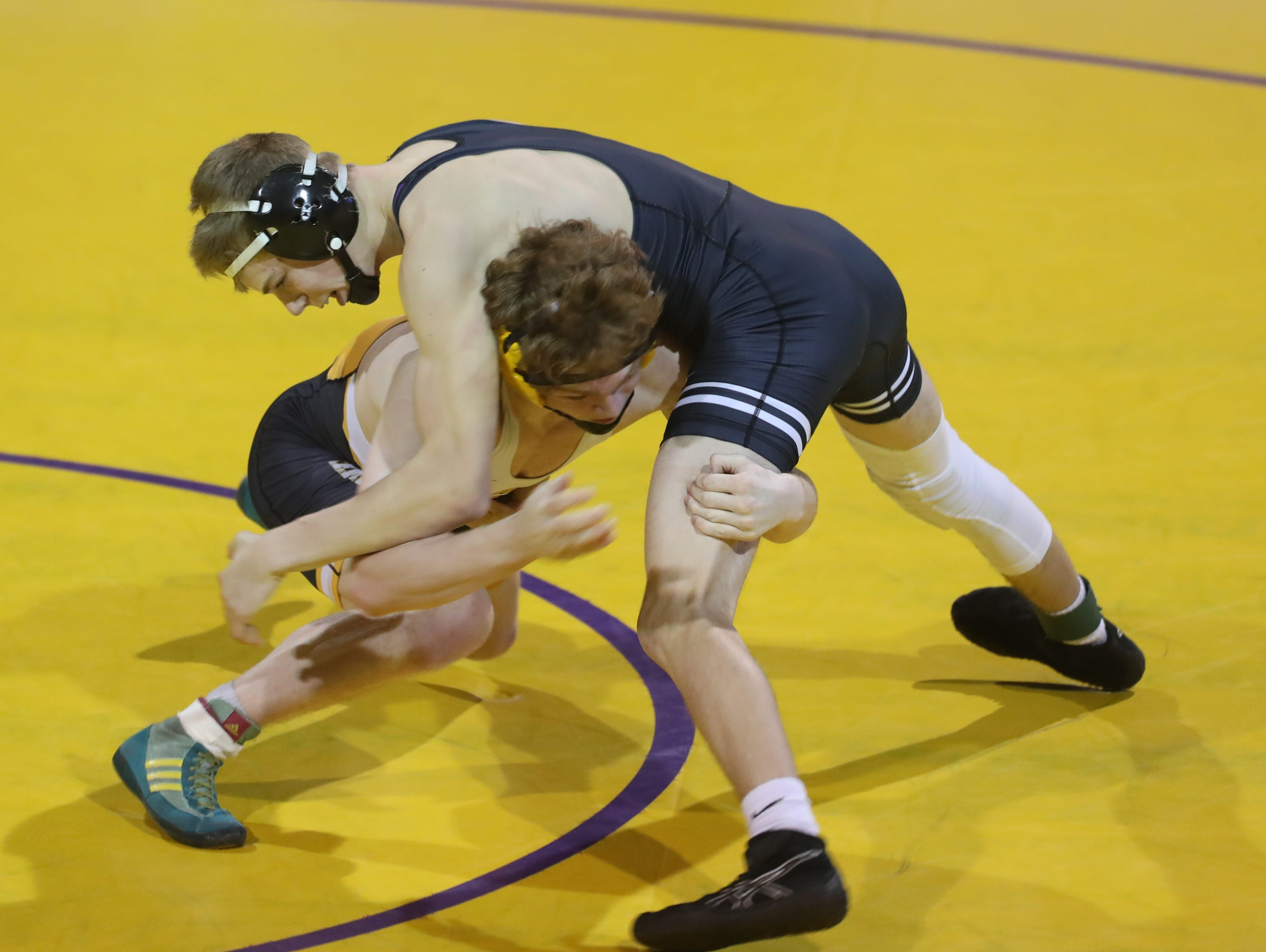 Dec 11, 2018; Waukee, IA  USA; 138 lb Nathan Marchand (Southeast Polk) over Cody Anderson (Waukee) (MD 11-3) at Waukee High School. The Rams beat the Warriors 69 to 6.  Mandatory Credit: Reese Strickland-for the register
