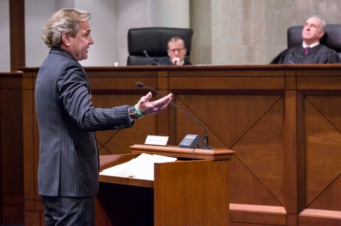 Attorney Mark Hedberg speaks to the Iowa Supreme Court as they hear arguments in two challenges to Iowa's collective bargaining law change last year. The challenges are from AFSCME and the Iowa State Education Association at the Judicial Building Wednesday, Dec. 12, 2018, in Des Moines, Iowa.
