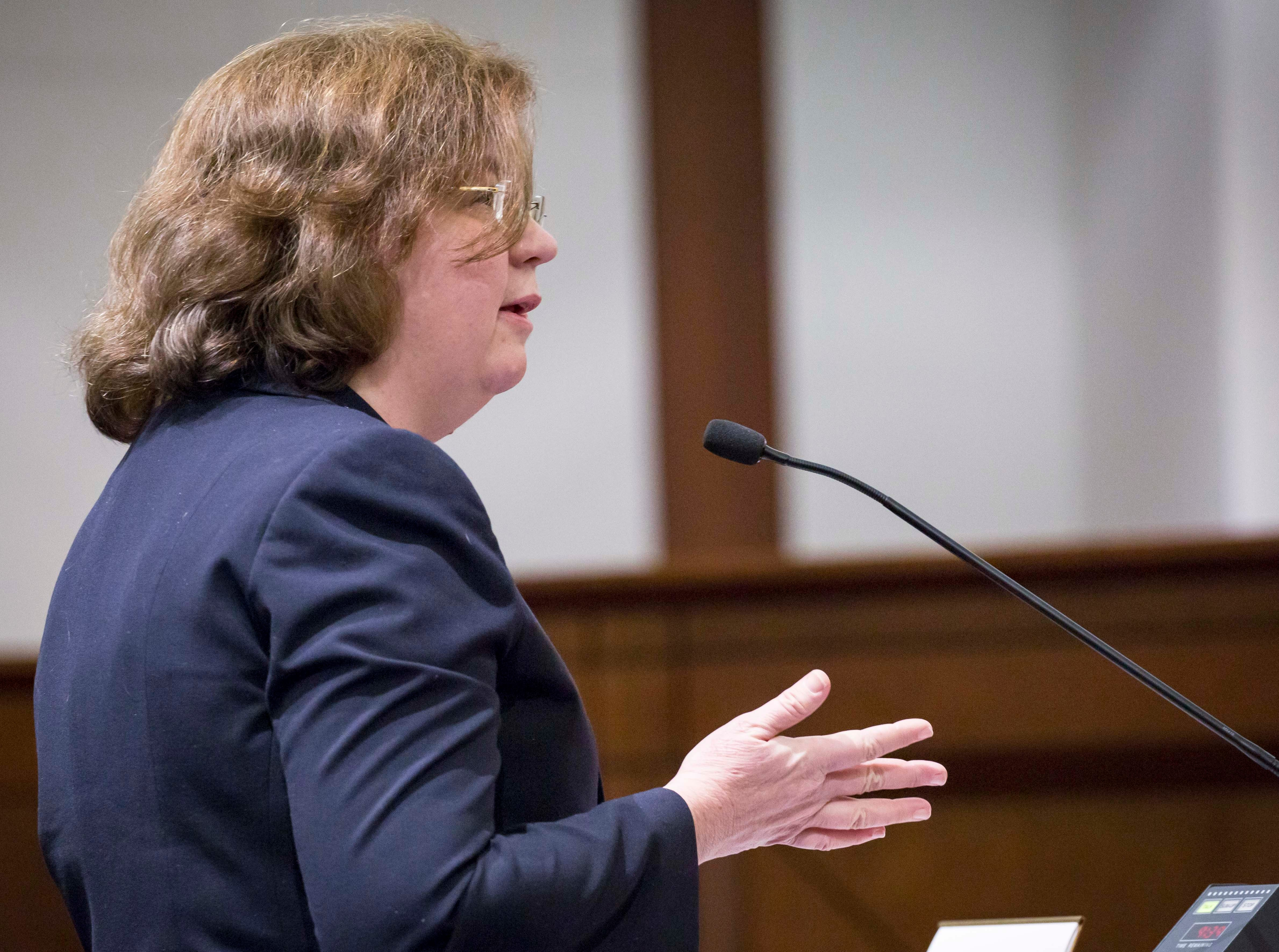 Attorney Alice O'Brian speaks to the Iowa Supreme Court as they hear arguments in two challenges to Iowa's collective bargaining law change last year. The challenges are from AFSCME and the Iowa State Education Association at the Judicial Building Wednesday, Dec. 12, 2018, in Des Moines, Iowa.