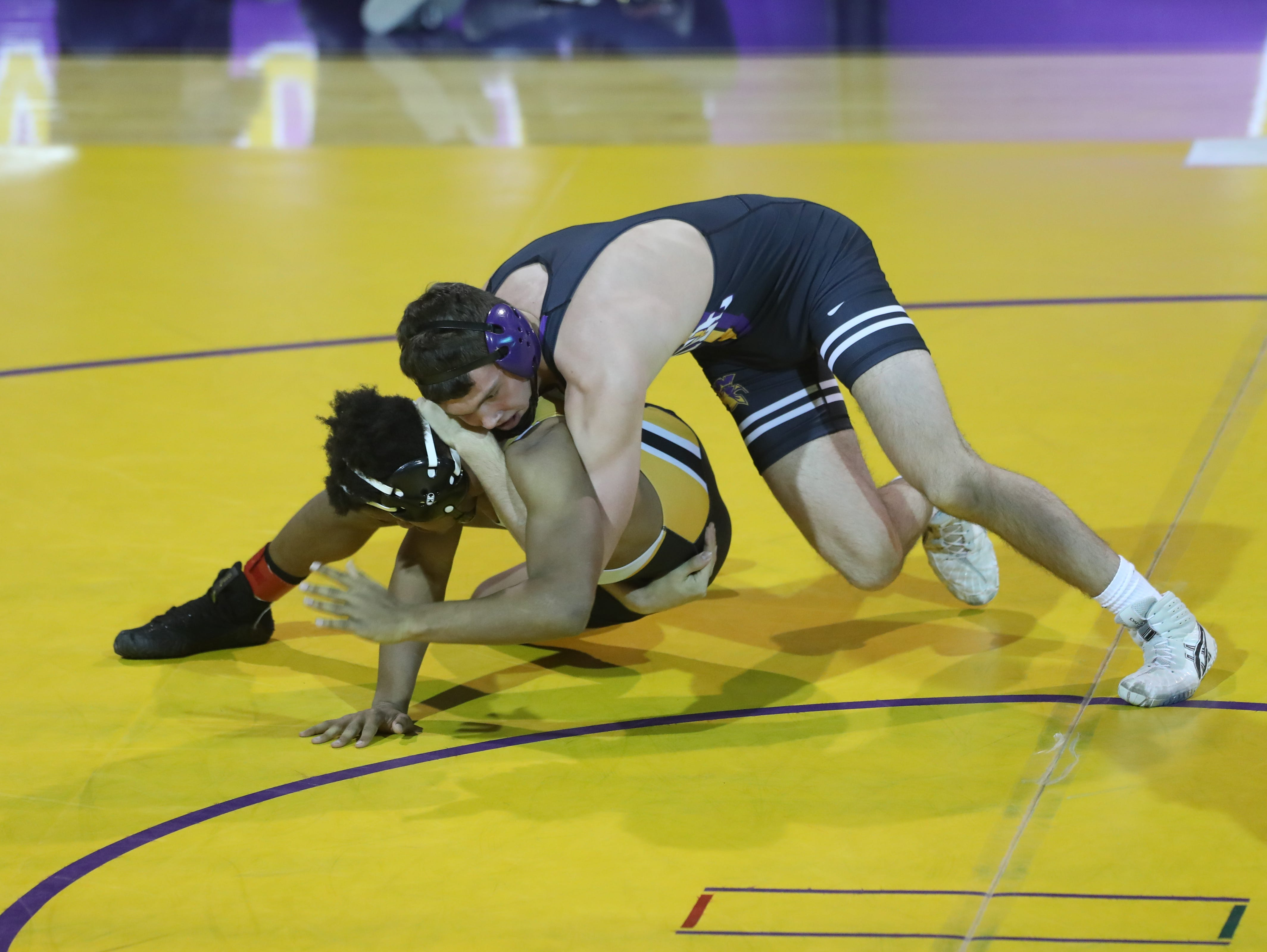 Dec 11, 2018; Waukee, IA  USA; 170 lb Anthony Zach (Waukee) over Deveyon Montgomery (Southeast Polk) (Fall 1:21) at Waukee High School. The Rams beat the Warriors 69 to 6.  Mandatory Credit: Reese Strickland-for the register