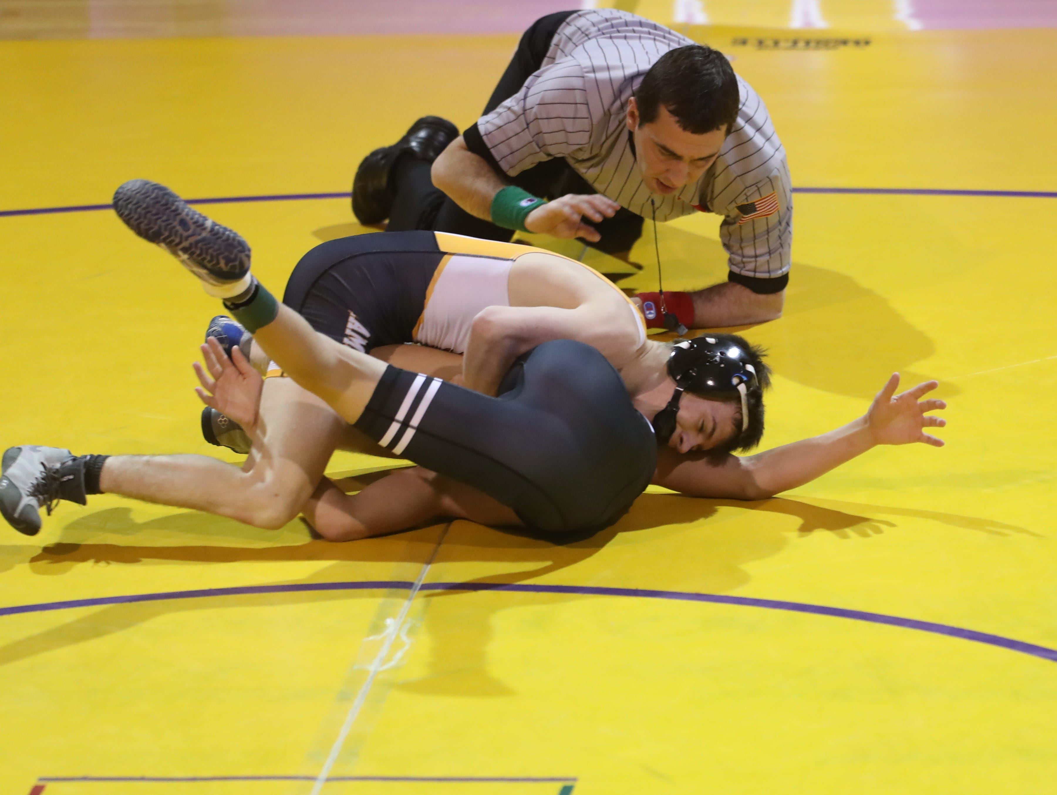 Dec 11, 2018; Waukee, IA  USA; 106 lb Kale Anderson (Southeast Polk) over Elijah Hofbauer (Waukee) (Fall 0:59) at Waukee High School. The Rams beat the Warriors 69 to 6.  Mandatory Credit: Reese Strickland-for the register