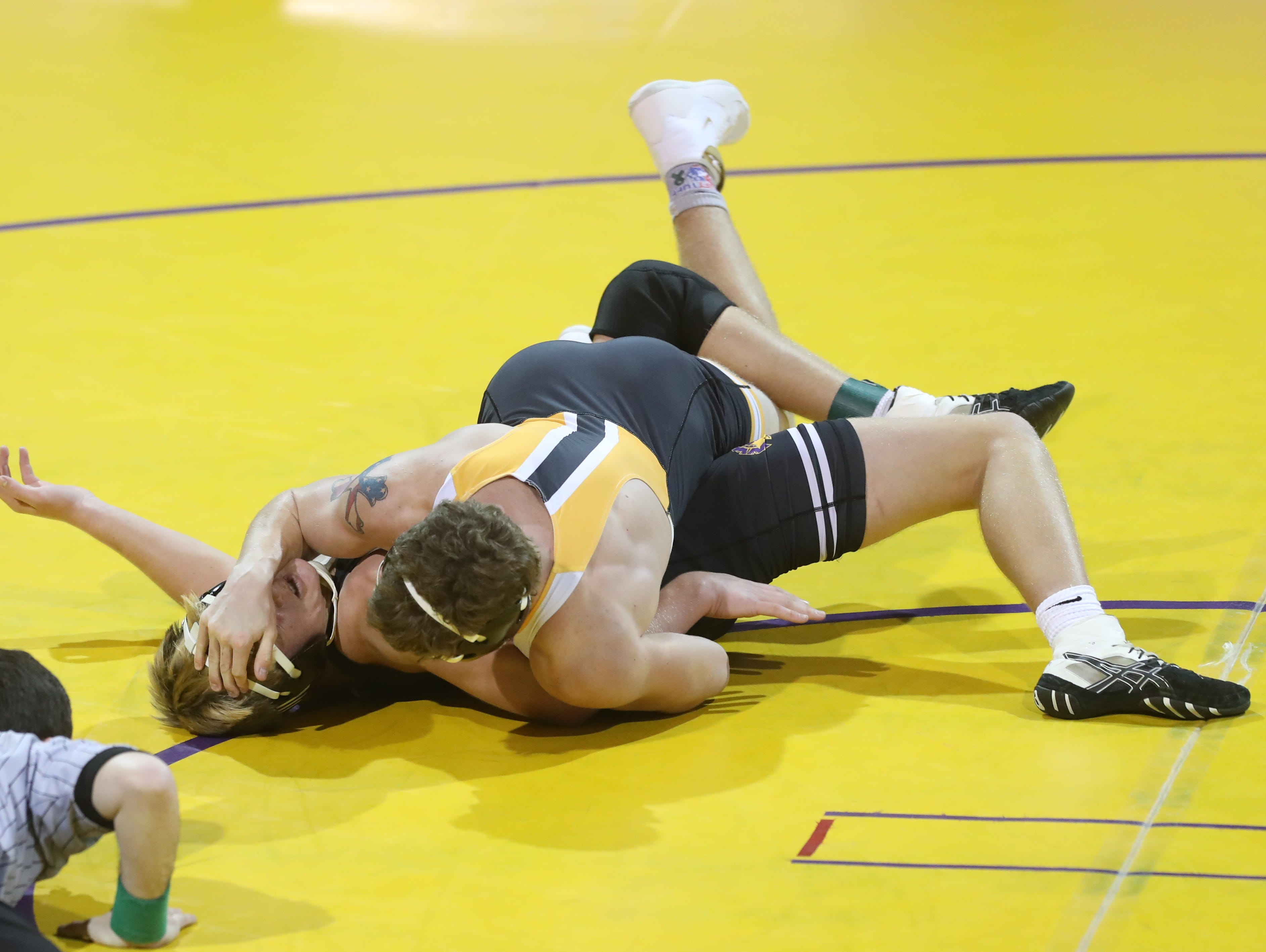 Dec 11, 2018; Waukee, IA  USA; 182 lb Justin Brindley (Southeast Polk) over Cole Spyksma (Waukee) (Fall 3:31) at Waukee High School. The Rams beat the Warriors 69 to 6.  Mandatory Credit: Reese Strickland-for the register