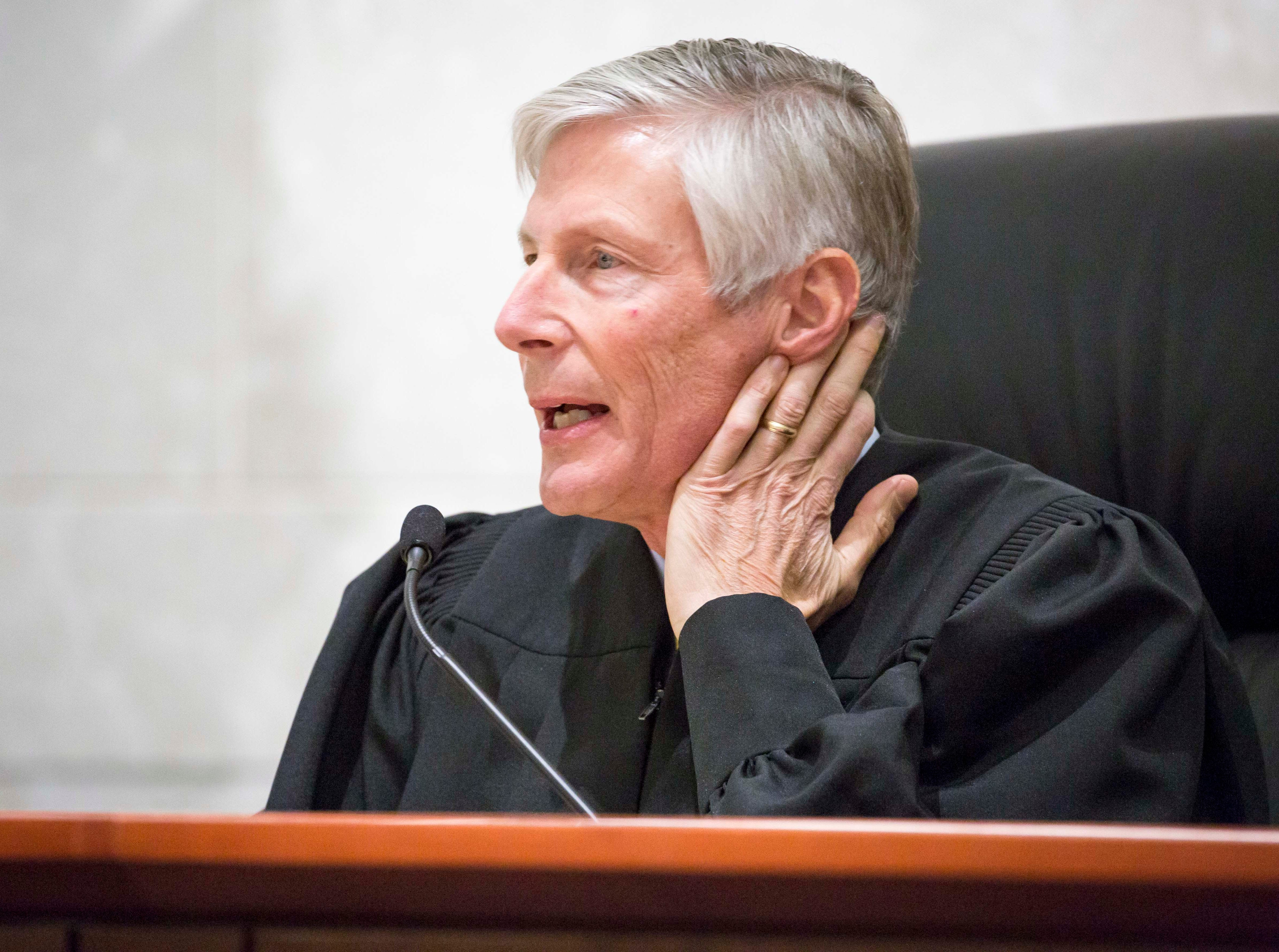 Justice Thomas D. Waterman talks to attorneys at the Iowa Supreme Court as they hear arguments in two challenges to Iowa's collective bargaining law change last year. The challenges are from AFSCME and the Iowa State Education Association at the Judicial Building Wednesday, Dec. 12, 2018, in Des Moines, Iowa.