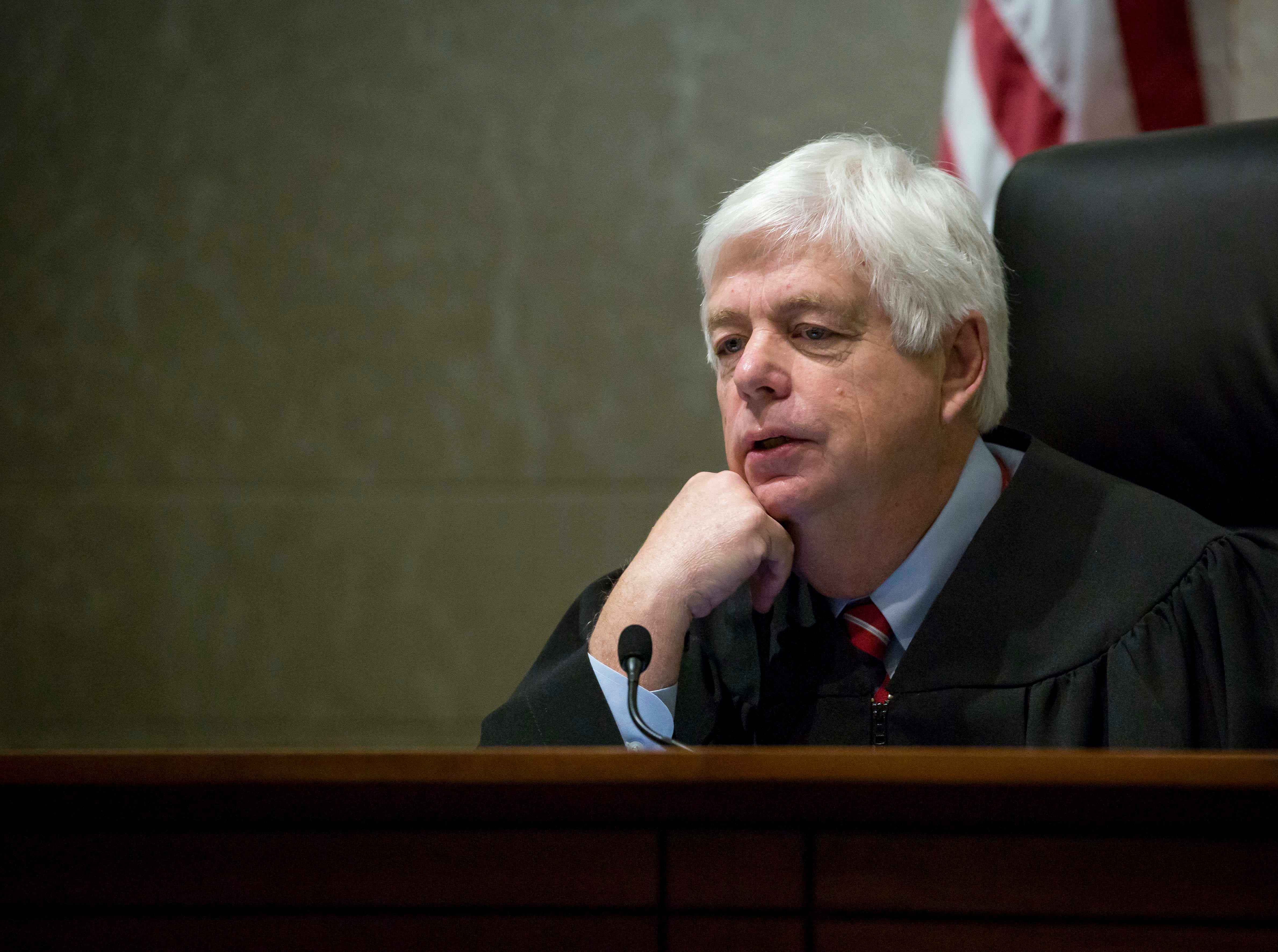 Justice David Wiggins talks to attorneys at the Iowa Supreme Court as they hear arguments in two challenges to Iowa's collective bargaining law change last year. The challenges are from AFSCME and the Iowa State Education Association at the Judicial Building Wednesday, Dec. 12, 2018, in Des Moines, Iowa.