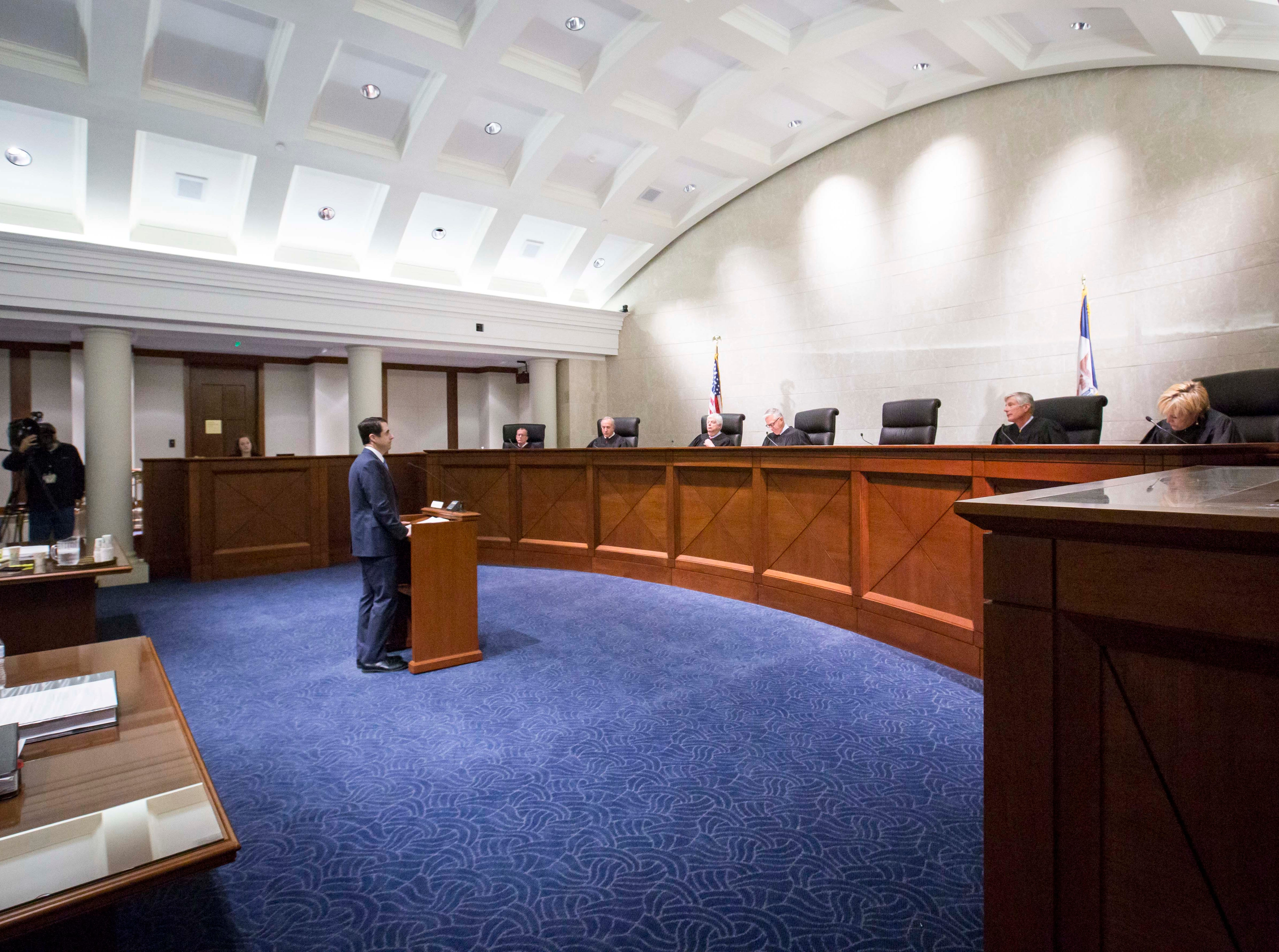 Attorney Matthew McDermott speaks to the Iowa Supreme Court as they hear arguments in two challenges to Iowa's collective bargaining law change last year. The challenges are from AFSCME and the Iowa State Education Association at the Judicial Building Wednesday, Dec. 12, 2018, in Des Moines, Iowa.