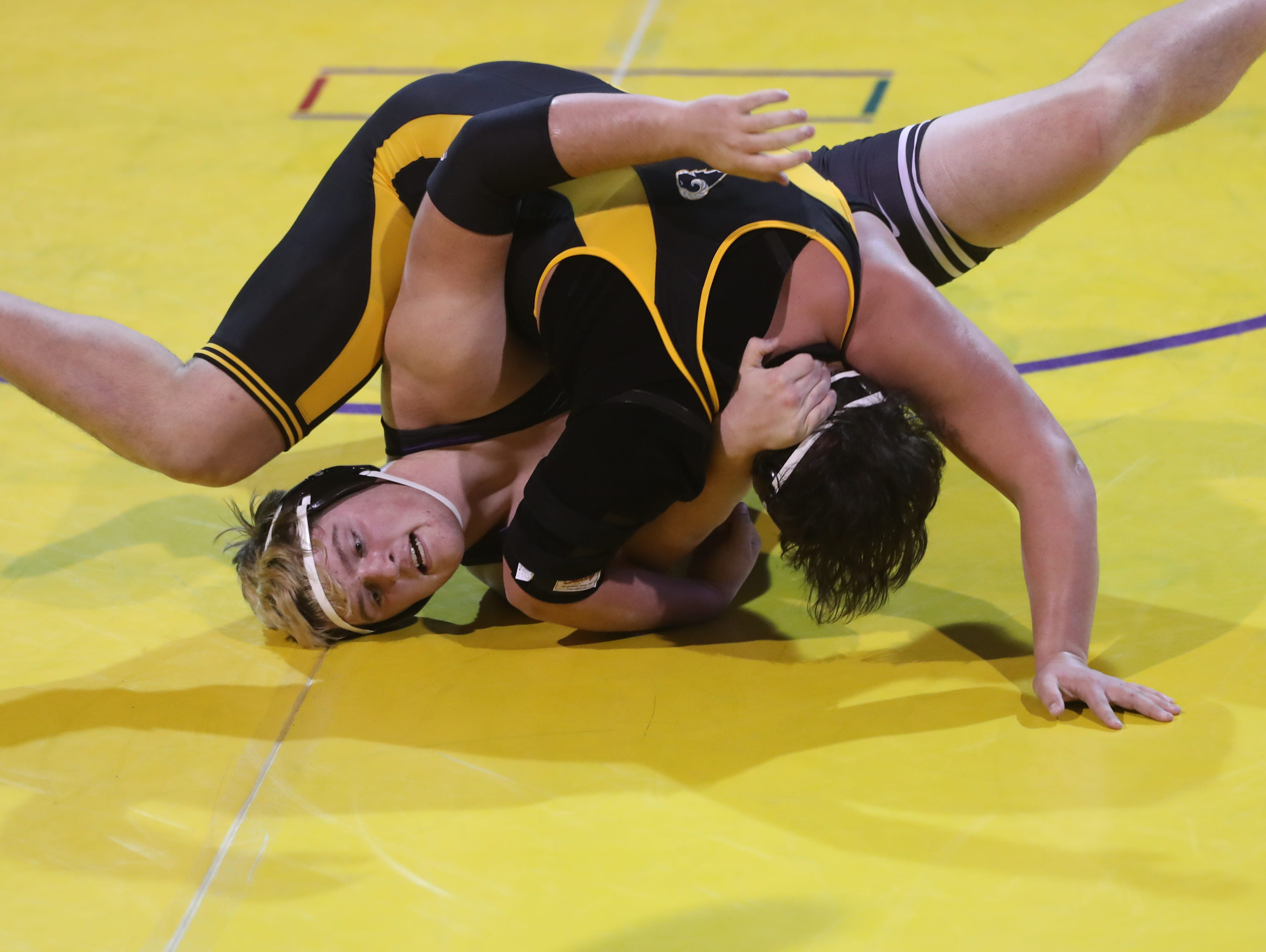 Dec 11, 2018; Waukee, IA  USA; 285 lb Aaron Martinez (Southeast Polk) over Connor Arndt (Waukee) (Fall 3:20)  at Waukee High School. The Rams beat the Warriors 69 to 6.  Mandatory Credit: Reese Strickland-for the register