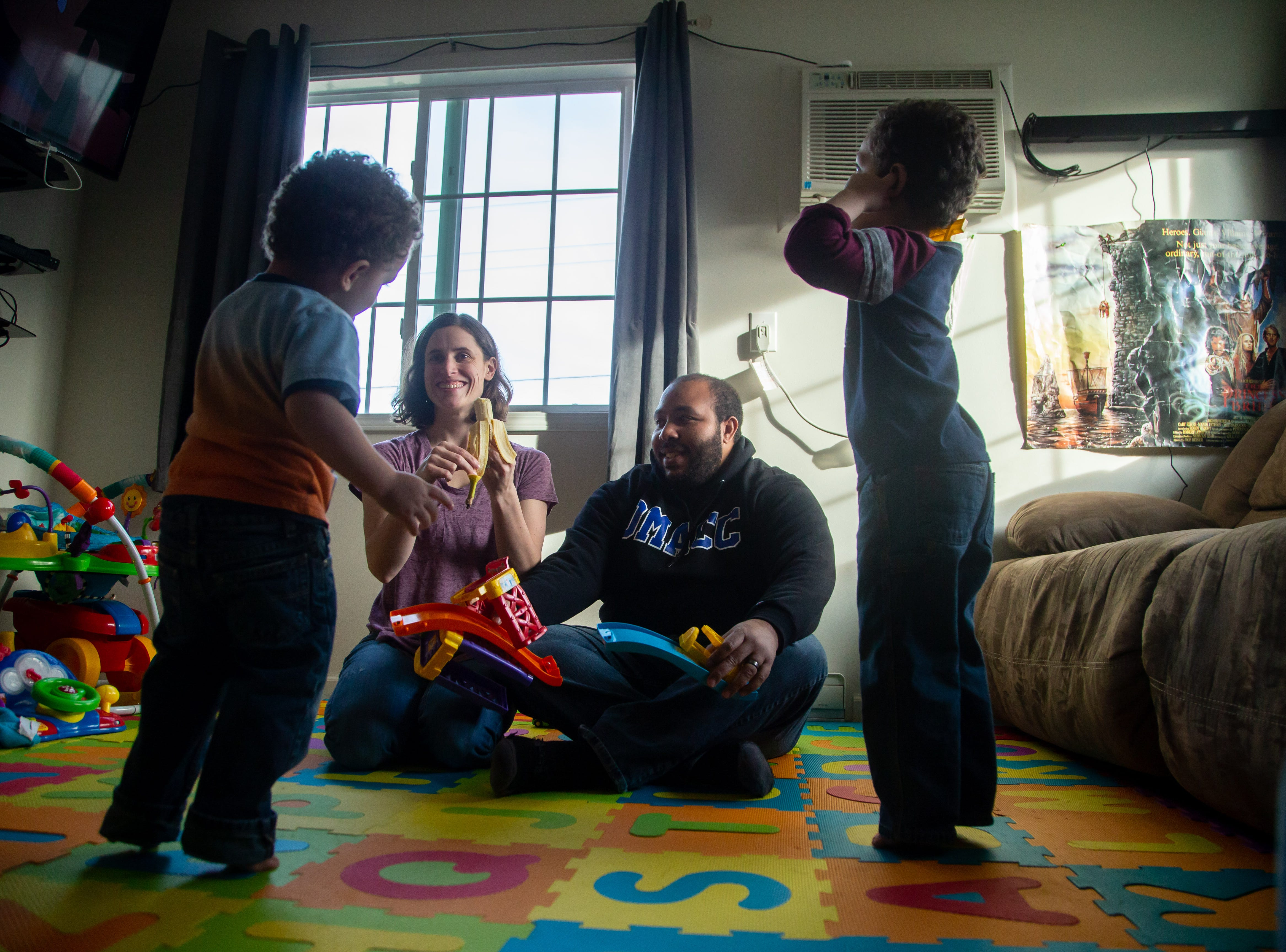 Andrea and Maurice McFalls play with their sons Oliver, 2, and Benjamin, 3, at their Des Moines apartment Tuesday, Dec. 11, 2018.