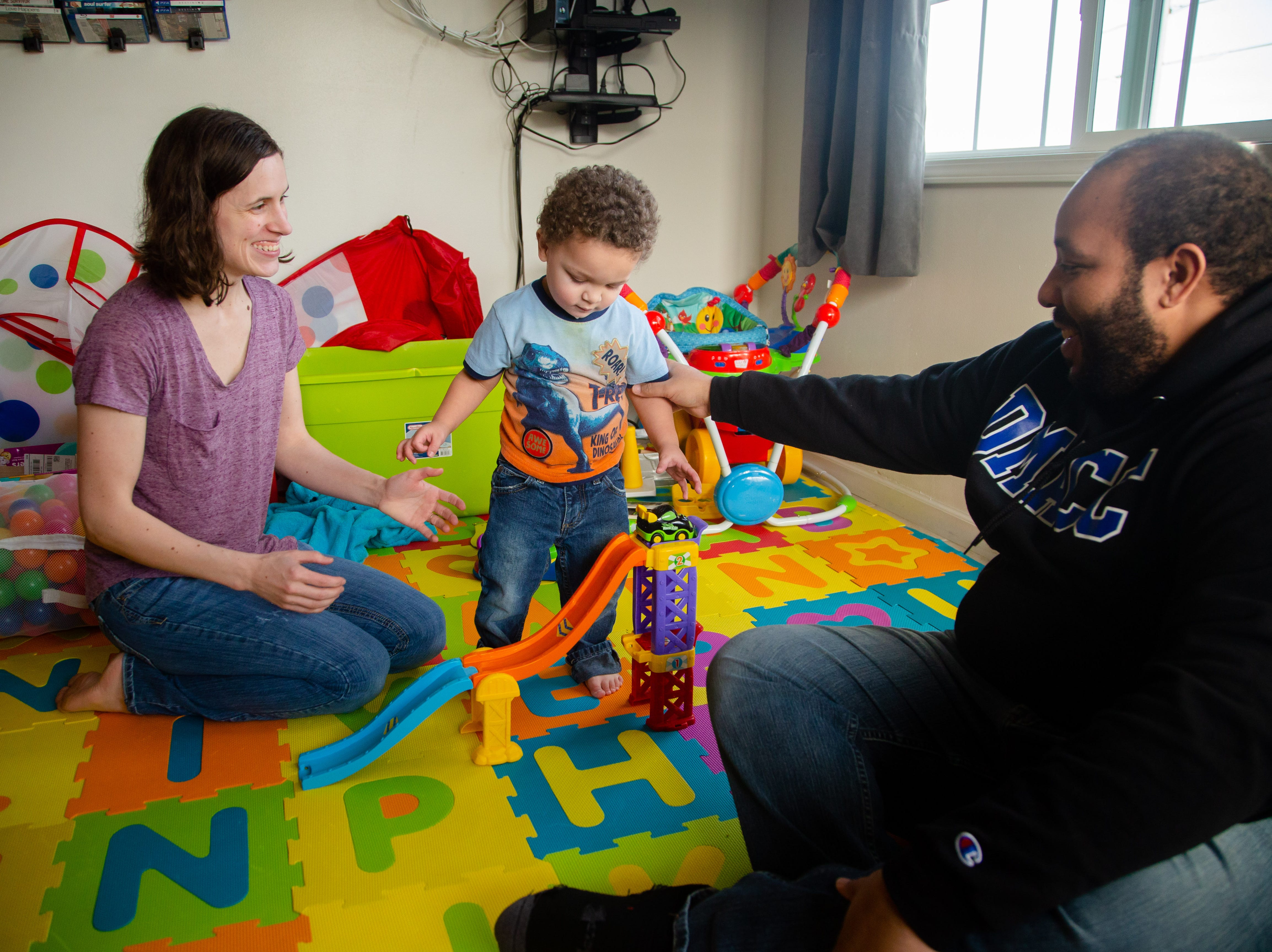 Andrea and Maurice McFalls play with their son Oliver McFalls at their Des Moines apartment Tuesday, Dec. 11, 2018.