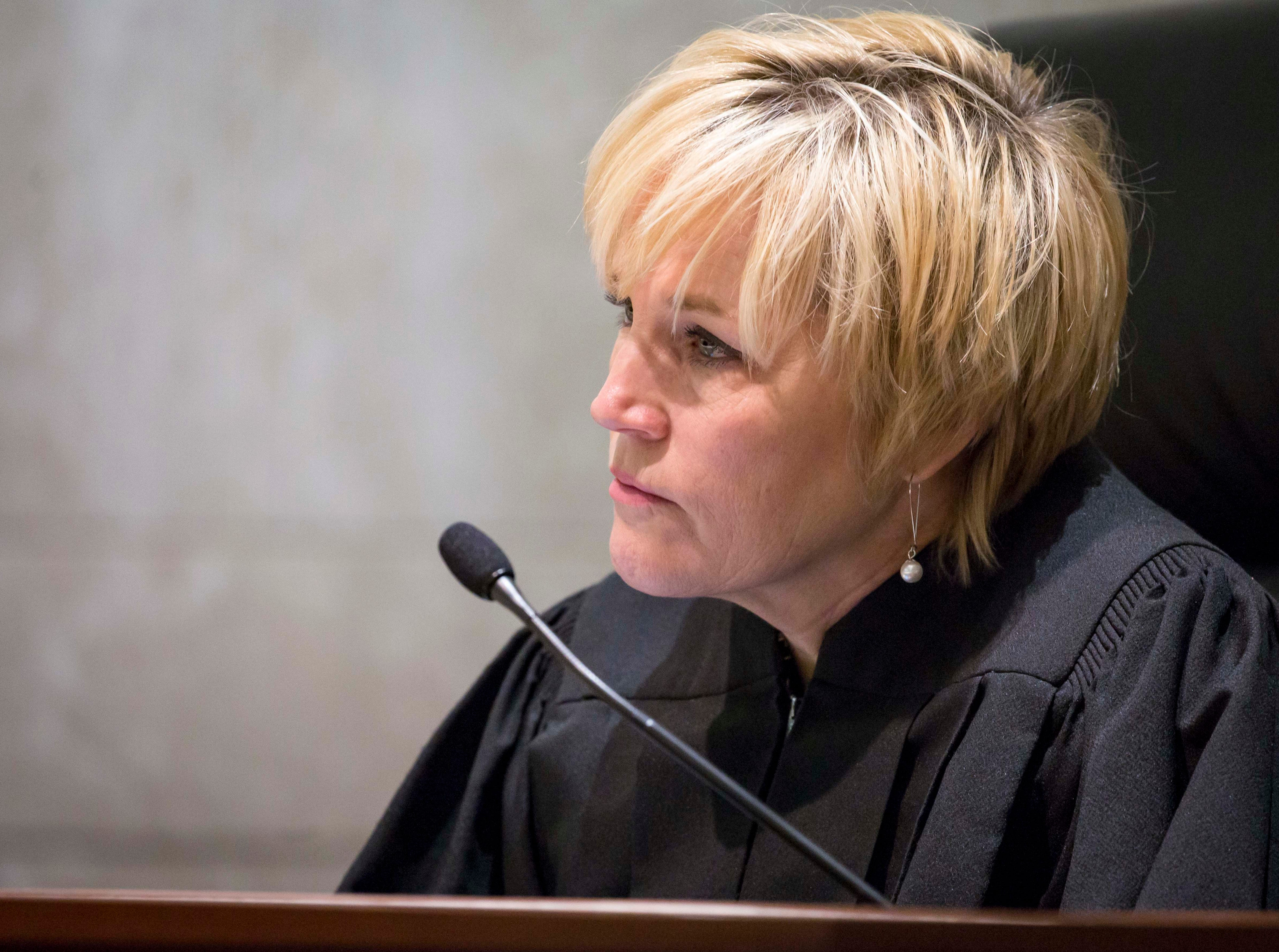 Justice Susan Christensen talks to attorneys at the Iowa Supreme Court as they hear arguments in two challenges to Iowa's collective bargaining law change last year. The challenges are from AFSCME and the Iowa State Education Association at the Judicial Building Wednesday, Dec. 12, 2018, in Des Moines, Iowa.