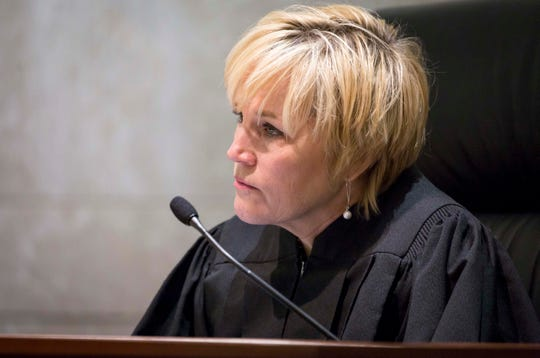 Justice Susan Christensen can be seen in this file photo talking to attorneys at the Iowa Supreme Court on Wednesday, Dec. 12, 2018, in Des Moines, Iowa.