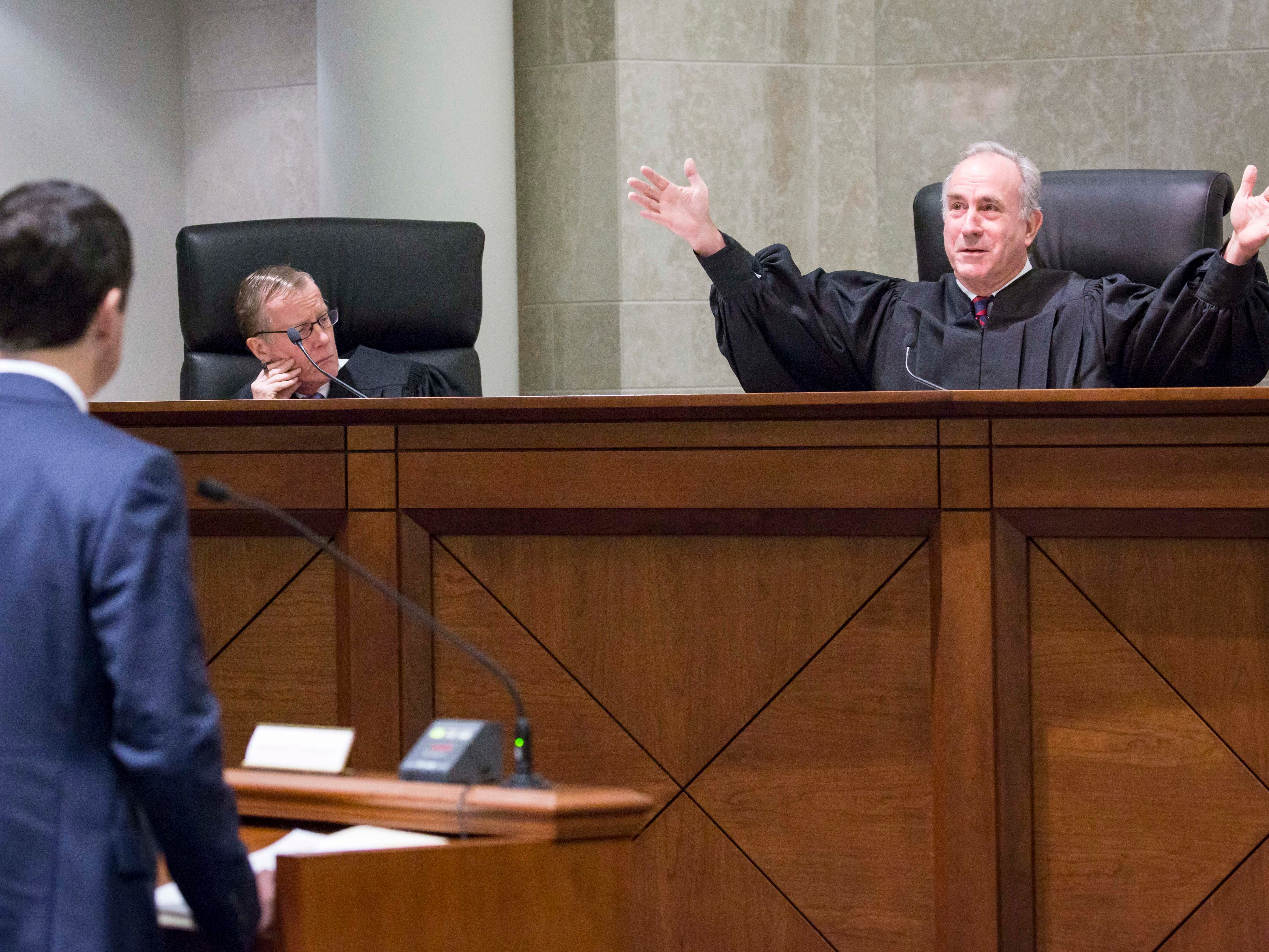 Justice Brent R. Appel talks to attorneys at the Iowa Supreme Court as they hear arguments in two challenges to Iowa's collective bargaining law change last year. The challenges are from AFSCME and the Iowa State Education Association at the Judicial Building Wednesday, Dec. 12, 2018, in Des Moines, Iowa.