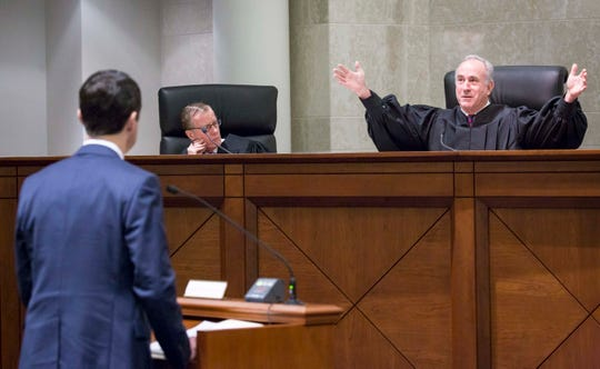 Justice Brent R. Appel talks to attorneys at the Iowa Supreme Court  at the Judicial Building Wednesday, Dec. 12, 2018, in Des Moines, Iowa.