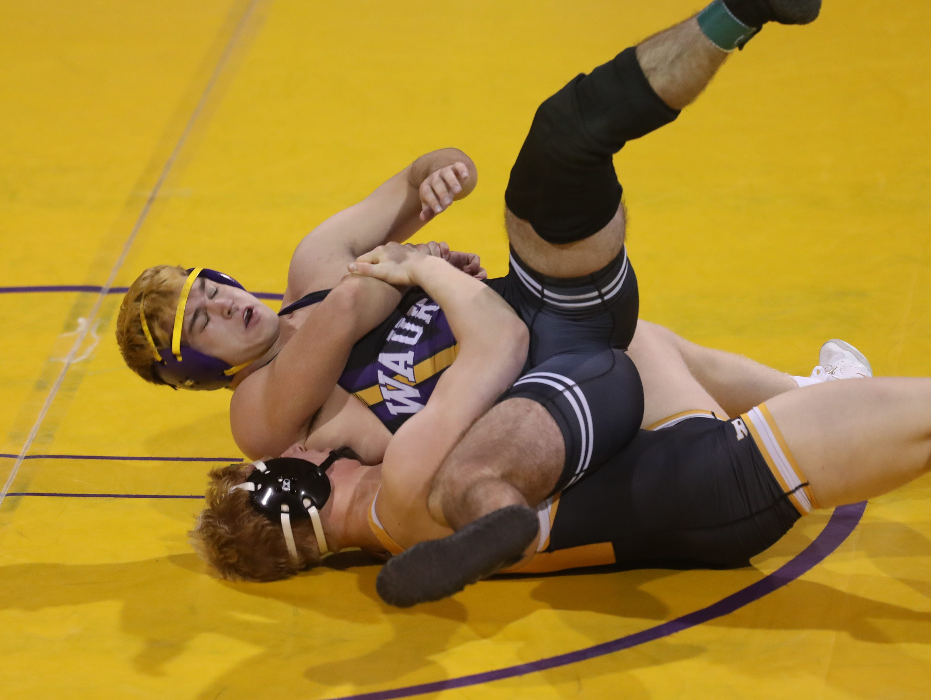 Dec 11, 2018; Waukee, IA  USA; 195 lb Gabe Christenson (Southeast Polk) over Gabe Gammell (Waukee) (TF 19-4 4:36) at Waukee High School. The Rams beat the Warriors 69 to 6.  Mandatory Credit: Reese Strickland-for the register