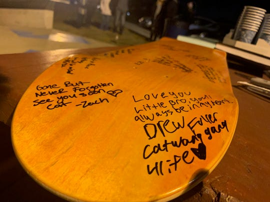 Messages from Anthony Taylor's friends and family are written on a brand-new skateboard deck Tuesday in Urbandale. Taylor died from a gunshot wound Sunday, Dec. 9, 2018. Police have not released any details surrounding the shooting.