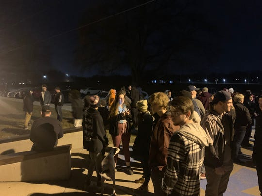 Friends and family gather Tuesday, Dec. 11, 2018 at the Urbandale skate park to remember Anthony Taylor. More than 50 people were in attendance. The 20-year-old died from injuries suffered by a gunshot on Sunday.