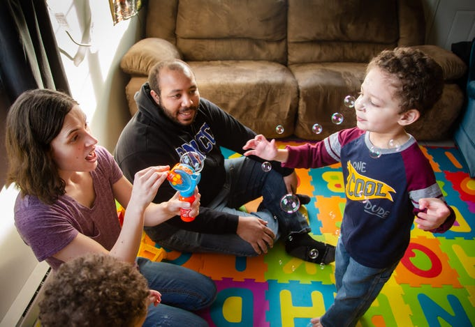 Andrea and Maurice McFalls play with their son Benjamin, 3, at their Des Moines apartment Tuesday, Dec. 11, 2018.
