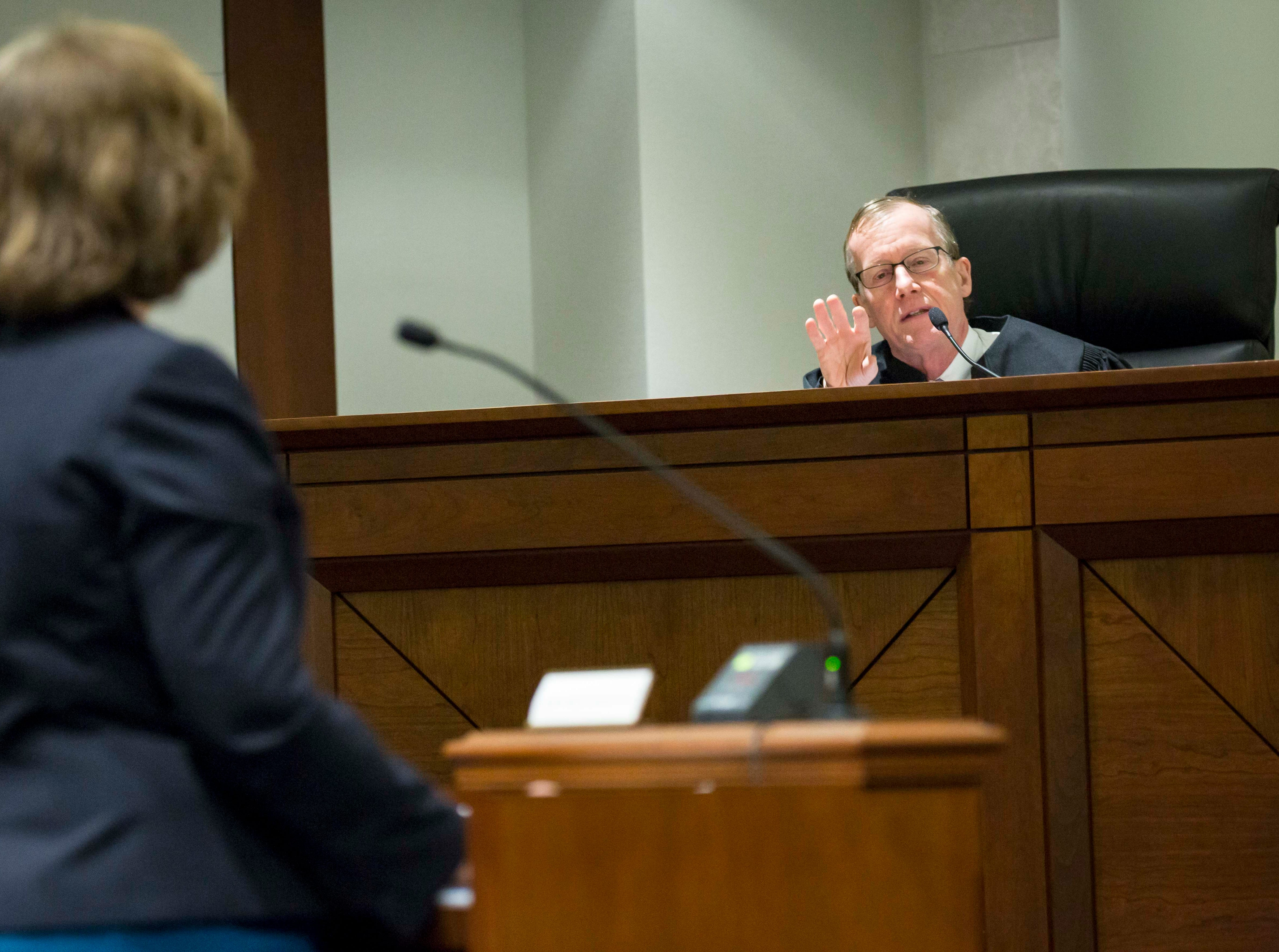 Justice Edward M. Mansfield talks to attorneys at the Iowa Supreme Court as they hear arguments in two challenges to Iowa's collective bargaining law change last year. The challenges are from AFSCME and the Iowa State Education Association at the Judicial Building Wednesday, Dec. 12, 2018, in Des Moines, Iowa.