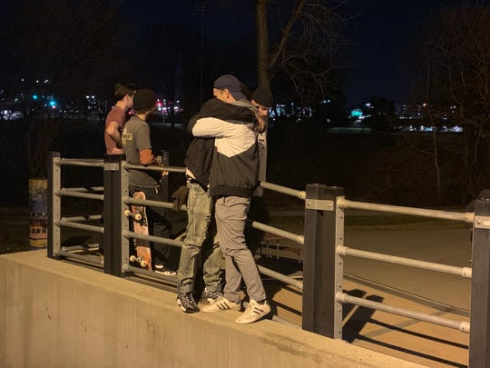 Matthew Long, right, hugs a friend Tuesday during a vigil at a skate park in Urbandale to remember Anthony Taylor, who died from a gunshot wound Sunday, Dec. 9, 2018.