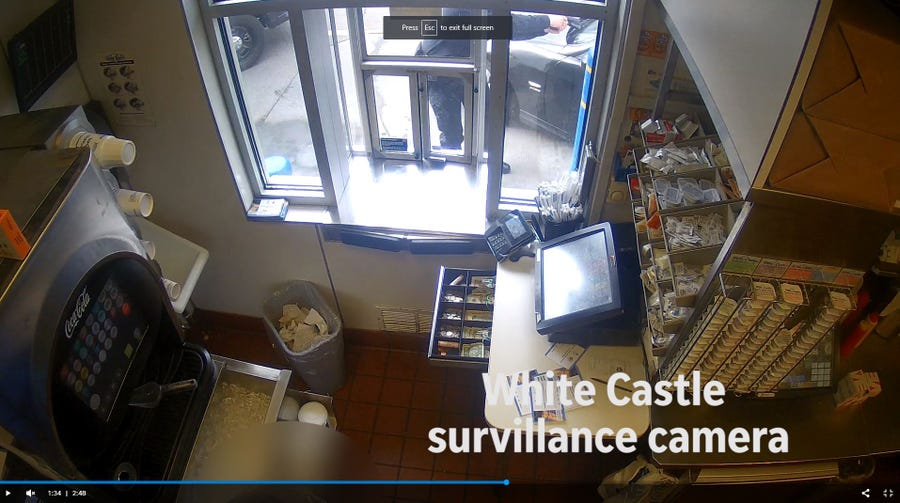 A screen grab from the surveillance video at White Castle shows the officer shooting Antonio Gordon on April 10, 2018.