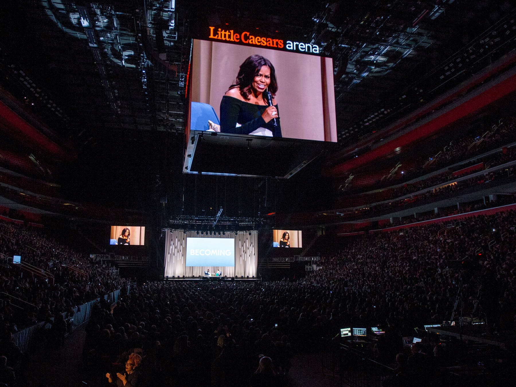 "Michelle Obama speaks during her ""Becoming"" book tour at the Little Caesars Arena in Detroit, Tuesday, Dec. 11, 2018."