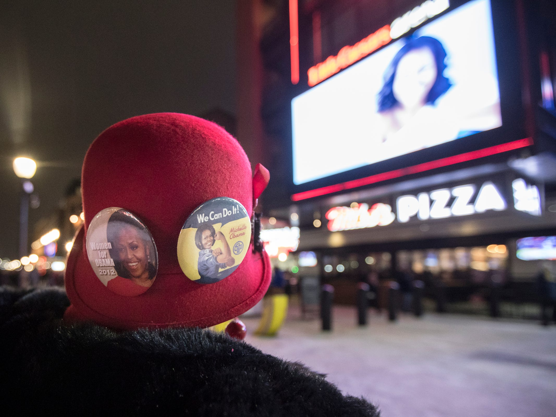 "Millie Hall of Detroit shows off her Obama buttons before attending Michelle Obama's ""Becoming"" book tour at the Little Caesars Arena in Detroit, Tuesday, Dec. 11, 2018."