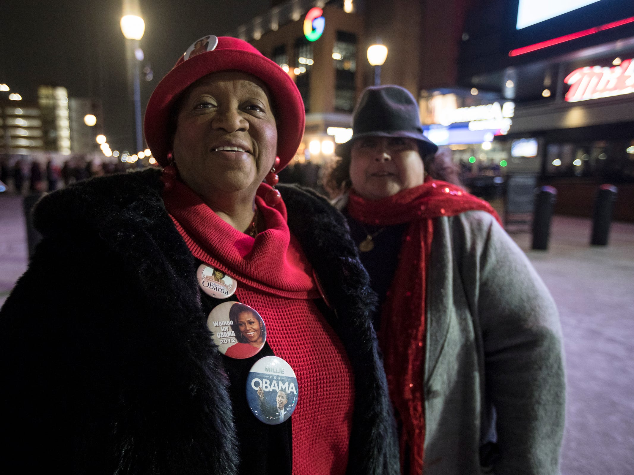 "Millie Hall of Detroit shows off her Obama buttons next to her friend Sandra Esparza of Livonia before Michelle Obama's ""Becoming"" book tour at the Little Caesars Arena in Detroit, Tuesday, Dec. 11, 2018."
