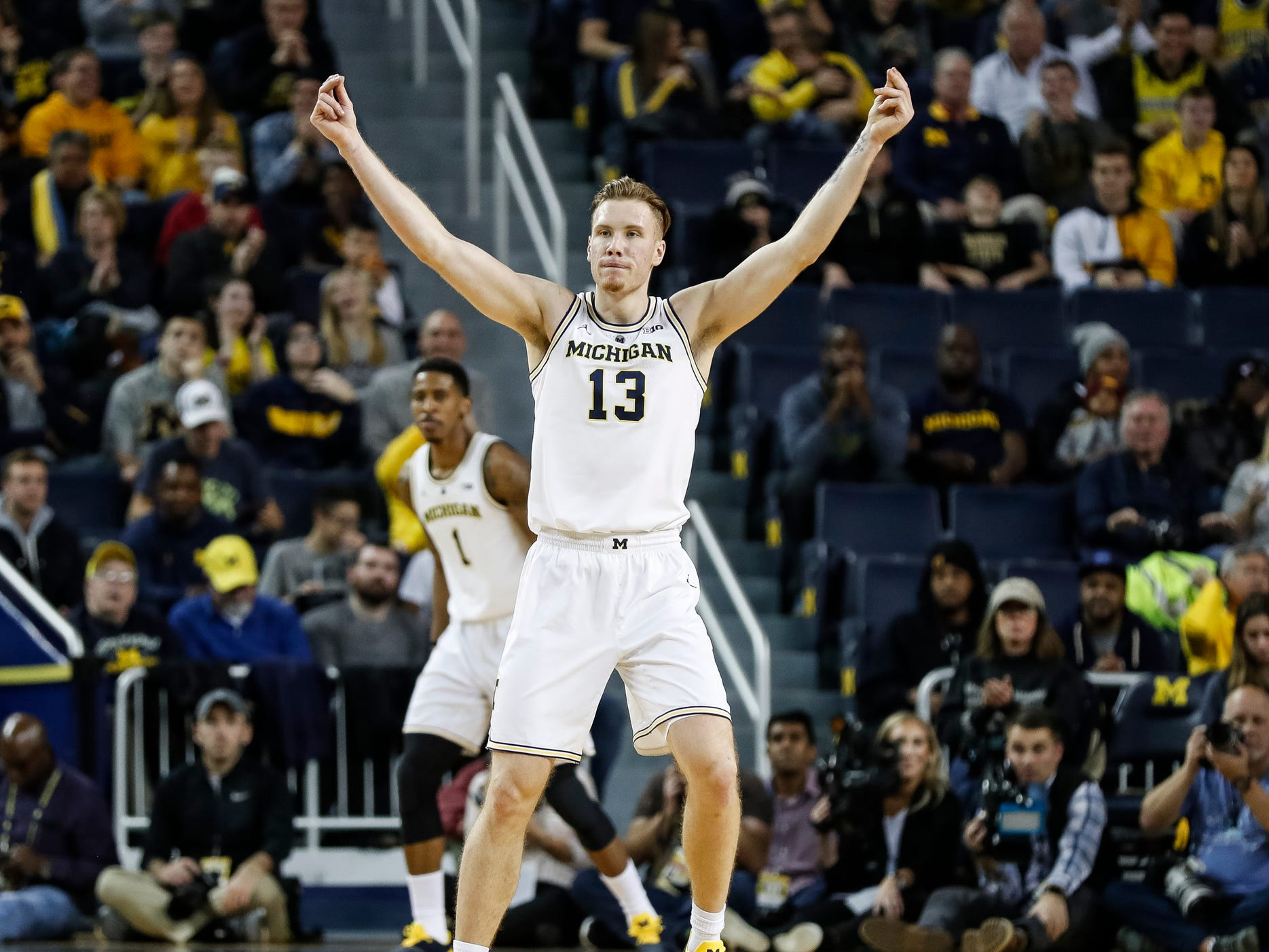 A lot has changed since our preseason rankings, as actual basketball games have been played, including conference games. Free Press writers Orion Sang, Nick Baumgardner and Chris Solari rank the Big Ten,  from 14 to 1. Let's take a look ... (stats as of Dec. 12)