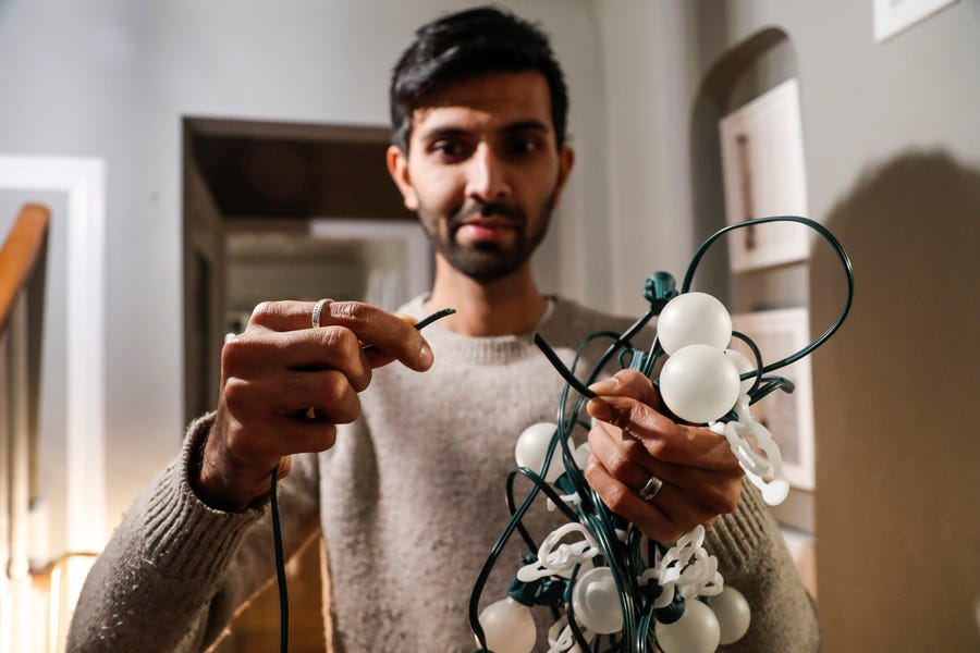 Perry Shah of Pleasant Ridge shows the broken lighting wire at his home in Pleasant Ridge, Friday, Dec. 7, 2018.