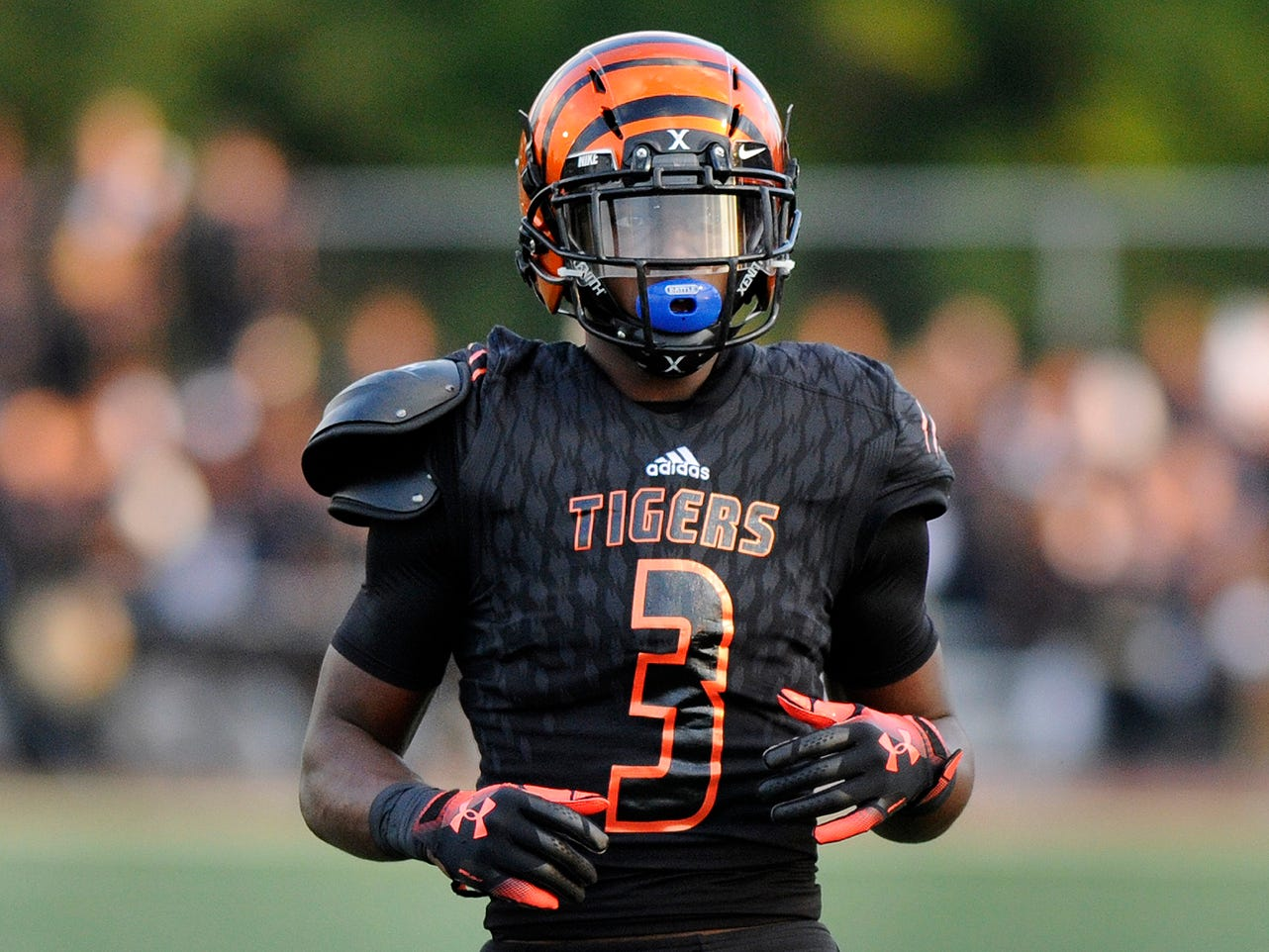 Go through the gallery to view The Detroit News top 15 Blue Chip high school football prospects, and where they're headed for college, The list includes Belleville's Julian Barnett, a Michigan State commitment. Player breakdowns by David Goricki of The Detroit News.