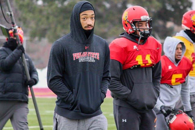Ferris State starting quarterback Jayru Campbell (Detroit Cass Tech) watches practices earlier this week. He didn't practice because he had an exam.