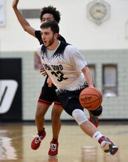 Dearborn Edsel Ford's Jalal Baydoun, who had 27 points in Monday's win over Gibraltar Carlson,  became the school's all-time leading scorer with more than 1,400 points.