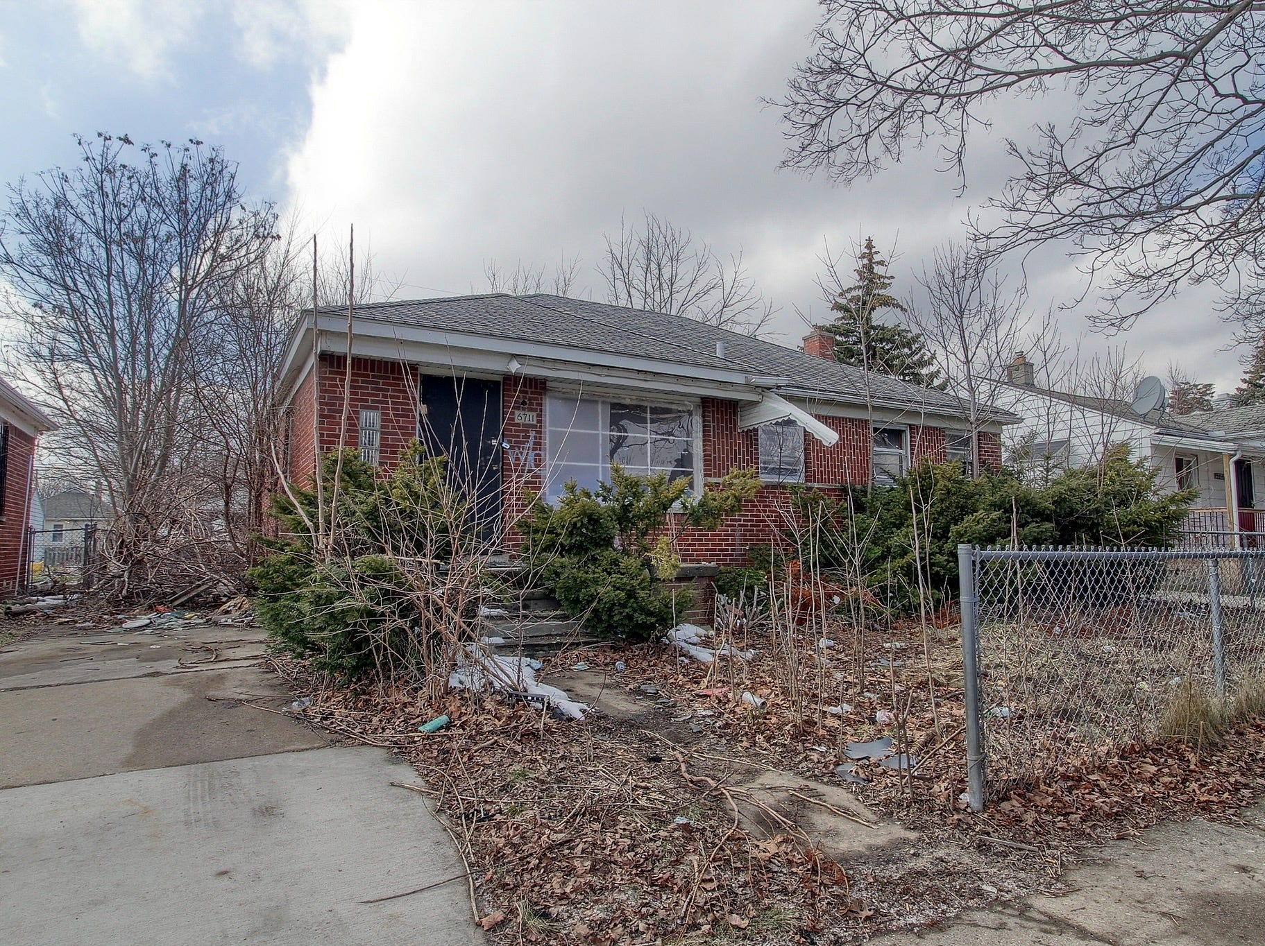 Before: This is how the exterior of Maria Walkenback's new home in Detroit's Warrendale neighborhood looked before it was renovated for her through the city's Bridging Neighborhoods home-swap program.