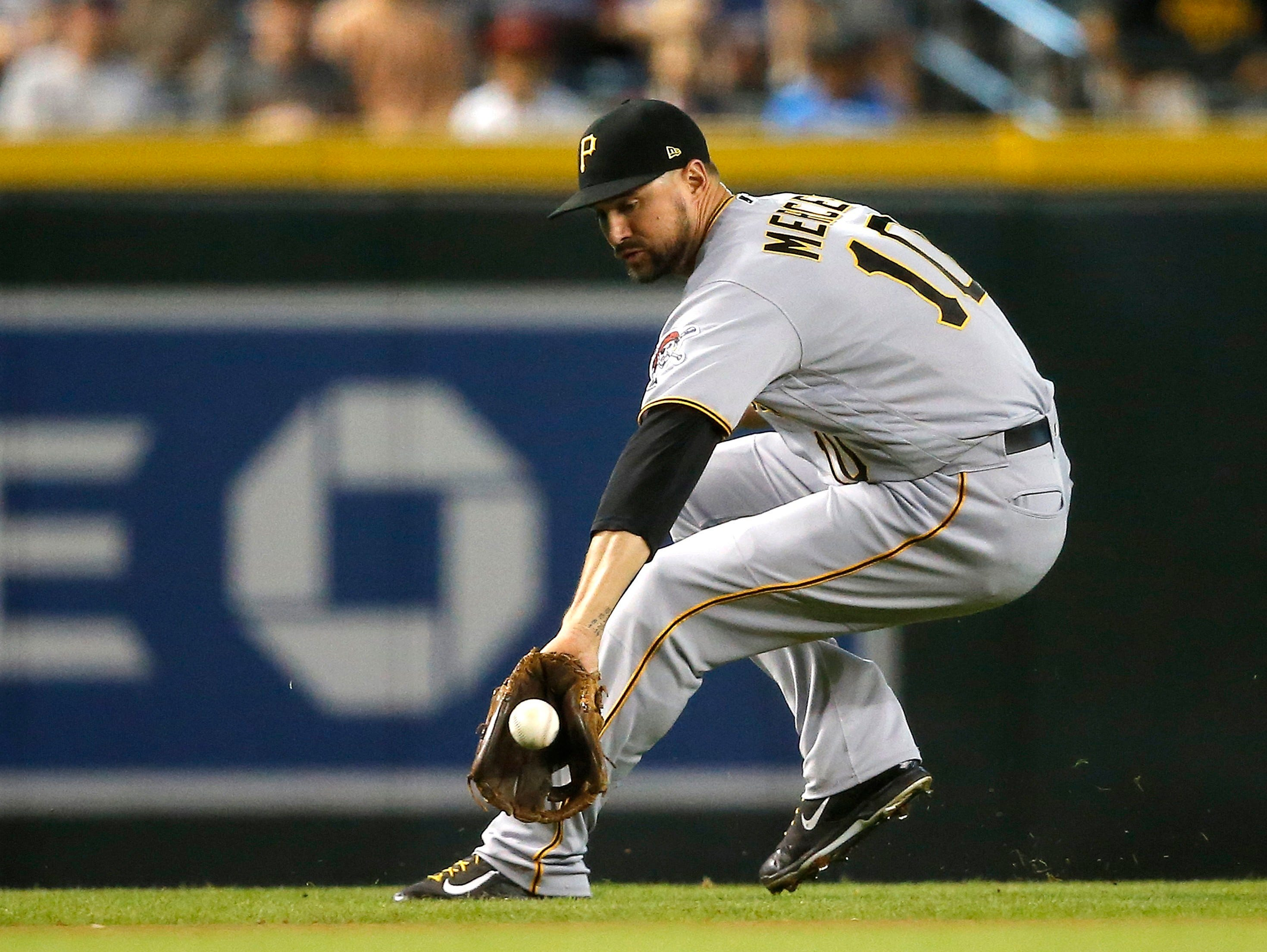 Pittsburgh Pirates' Jordy Mercer backhands a grounder during the first inning of a game against the Arizona Diamondbacks Wednesday, June 13, 2018, in Phoenix.