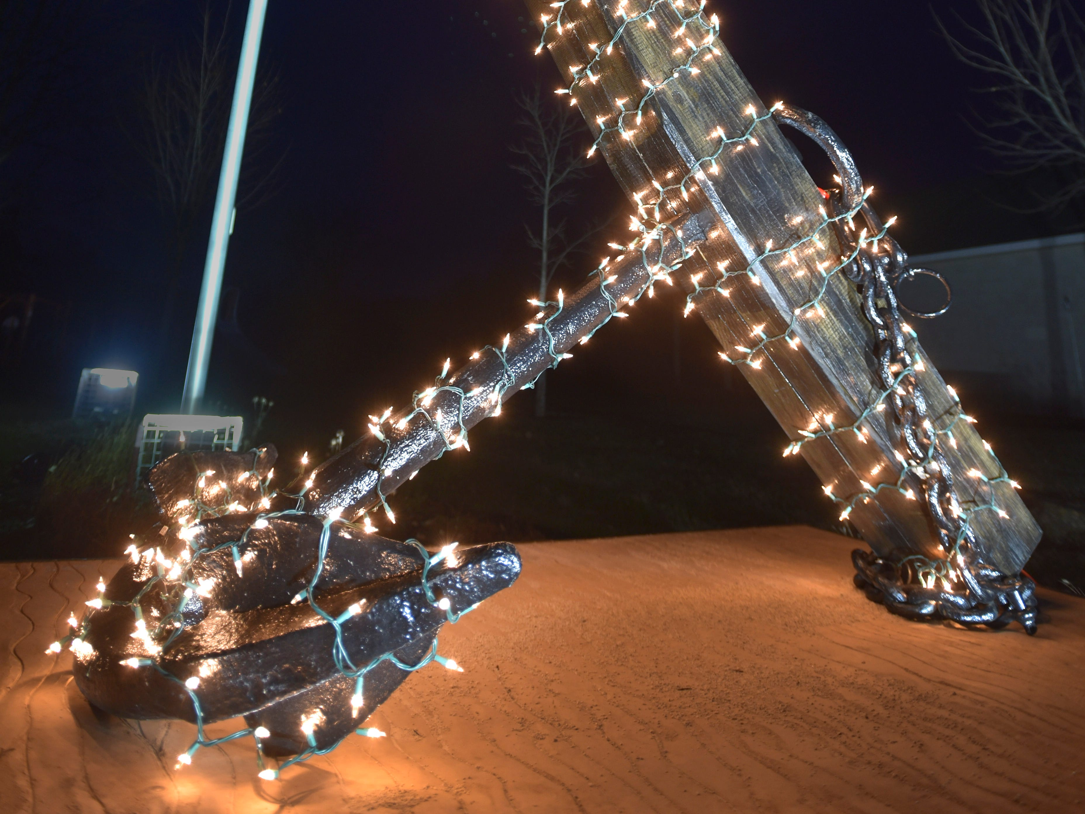 In honor of U.S. Navy Seal Chief Petty Officer Jason Freiwald, this 1,000-pound anchor is decorated with Christmas lights at his Armada Township park memorial, Wednesday night, Dec. 12, 2018. Freiwald, an Armada High School graduate, was killed in action during a deployment on Sept. 11, 2008. The anchor is from the 1840s and believed to be from a wooden schooner. The memorial was dedicated at noon, Sunday, Sept. 11, 2018.